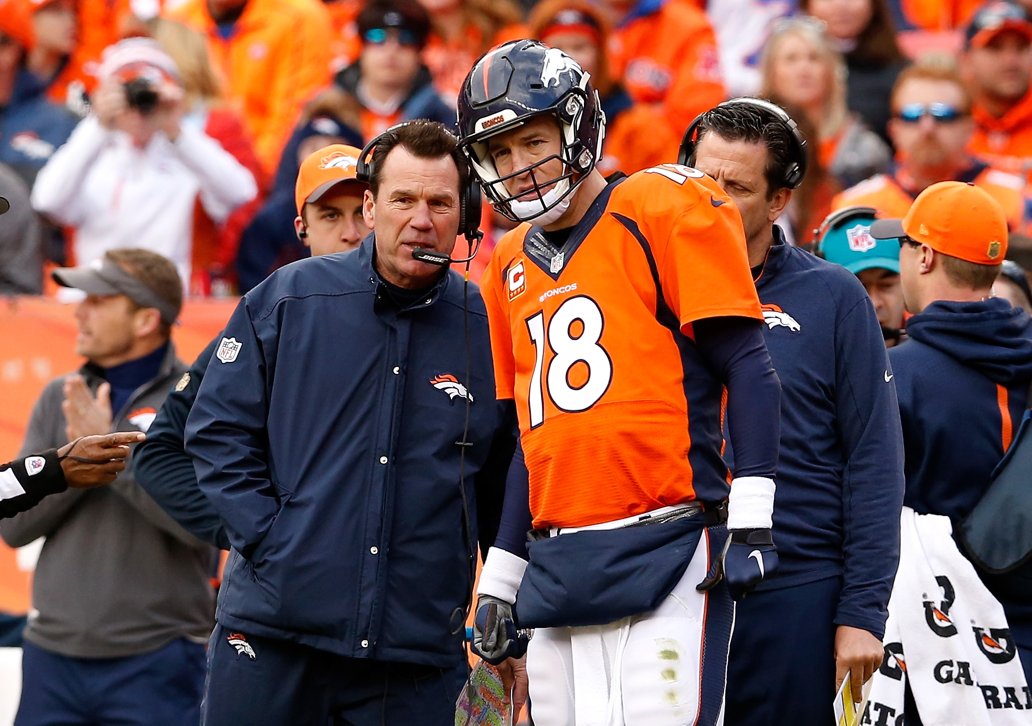 Gary Kubiak of the Denver Broncos speaks to Peyton Manning #18 in the first half against the New England Patriots in the AFC Championship game at Sports Authority Field at Mile High on January 24, 2016 in Denver, Colorado. (Photo by Christian Petersen/Getty Images)