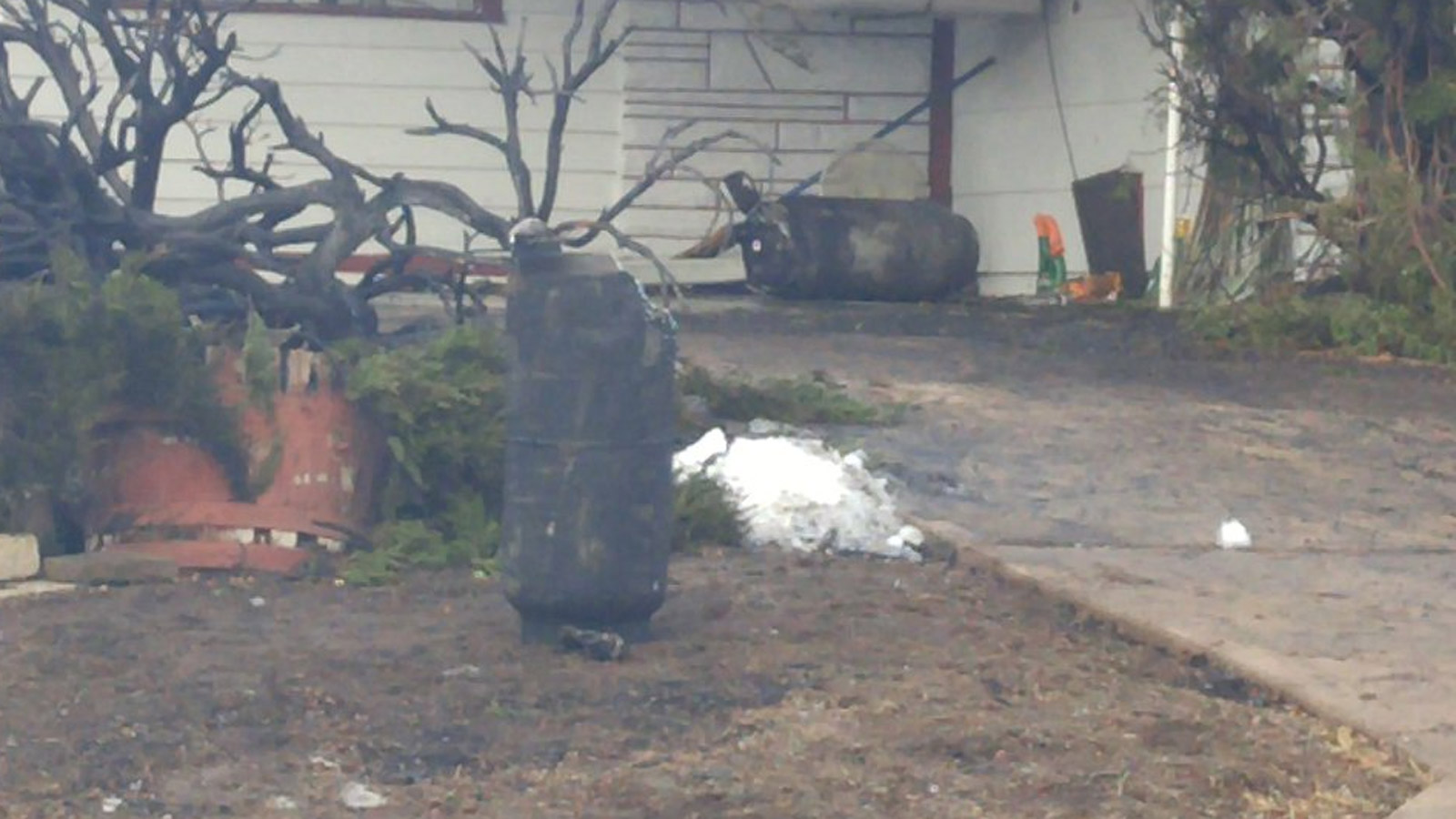 Several propane tanks were scattered around the neighborhood after the explosions (credit: CBS)