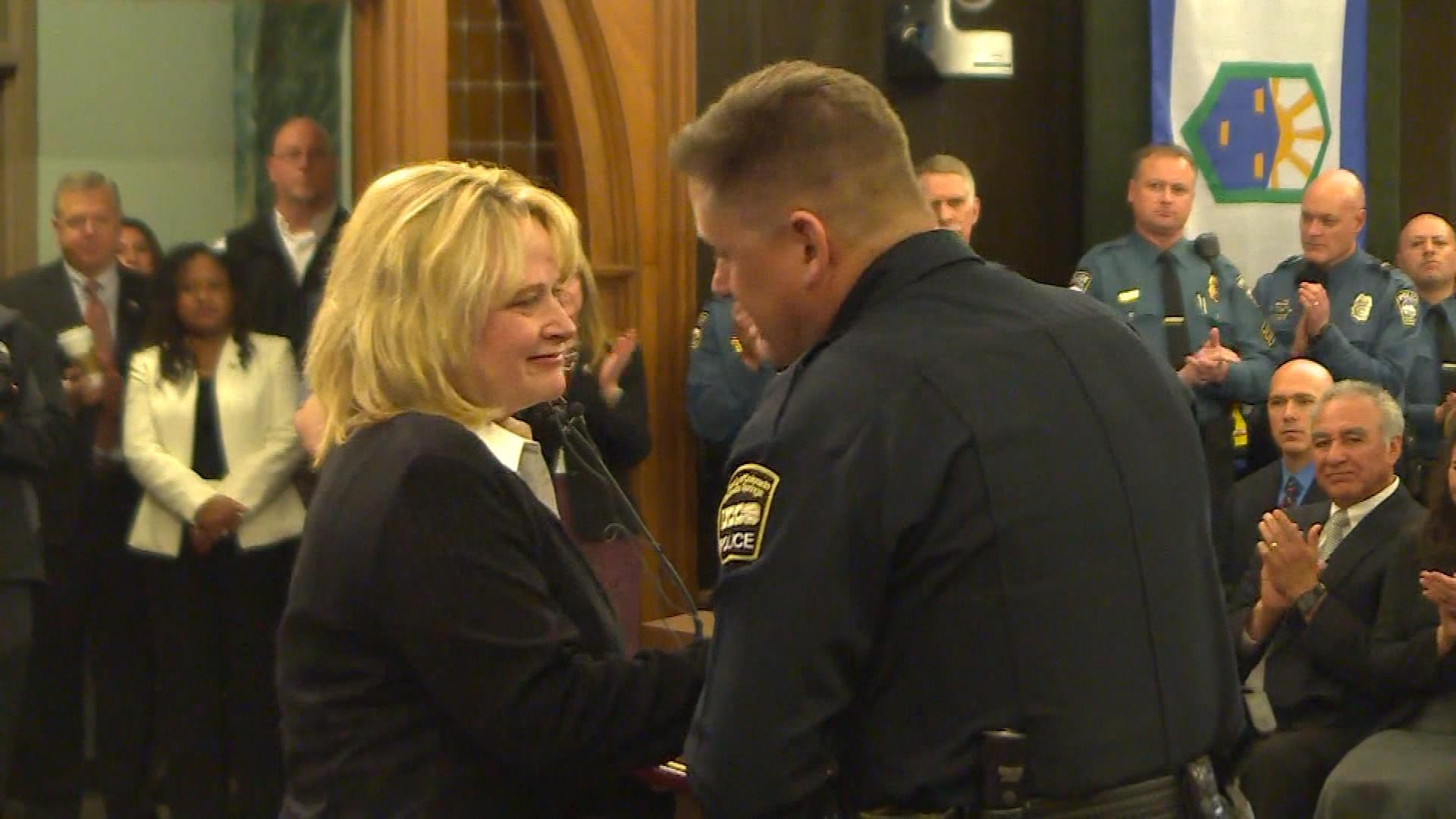 Attorney General Cynthia Coffman talks with a first responder (credit: CBS)