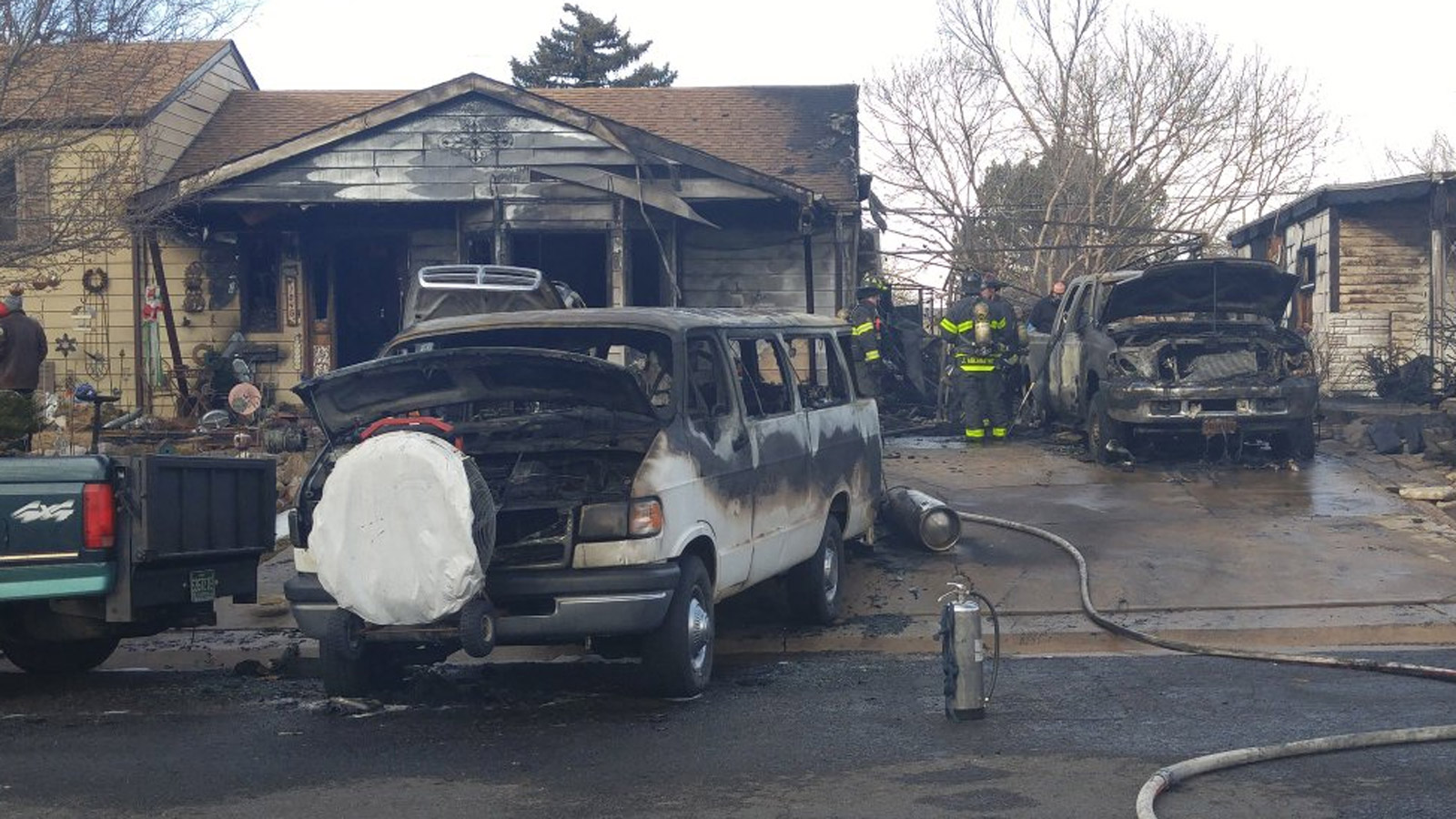 The explosions and fire also damaged two vehicles at the home on Yuma Street (credit: CBS)