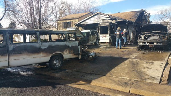 At least six propane tanks exploded in an early morning house fire on Yuma Street (credit: CBS)