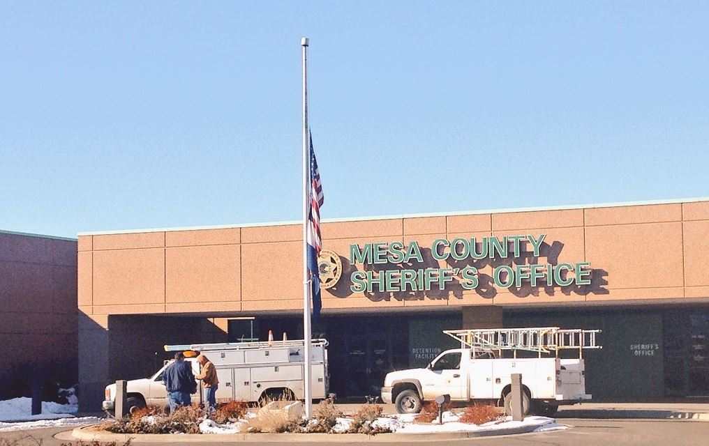 The flag at half-staff at the Mesa County Sheriff's Office on Tuesday (credit: CBS)
