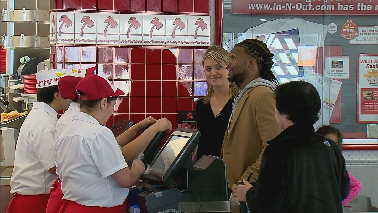 CBS4's Kelly Werthmann and Denver Bronco Omar Bolden at In & Out (credit: CBS)