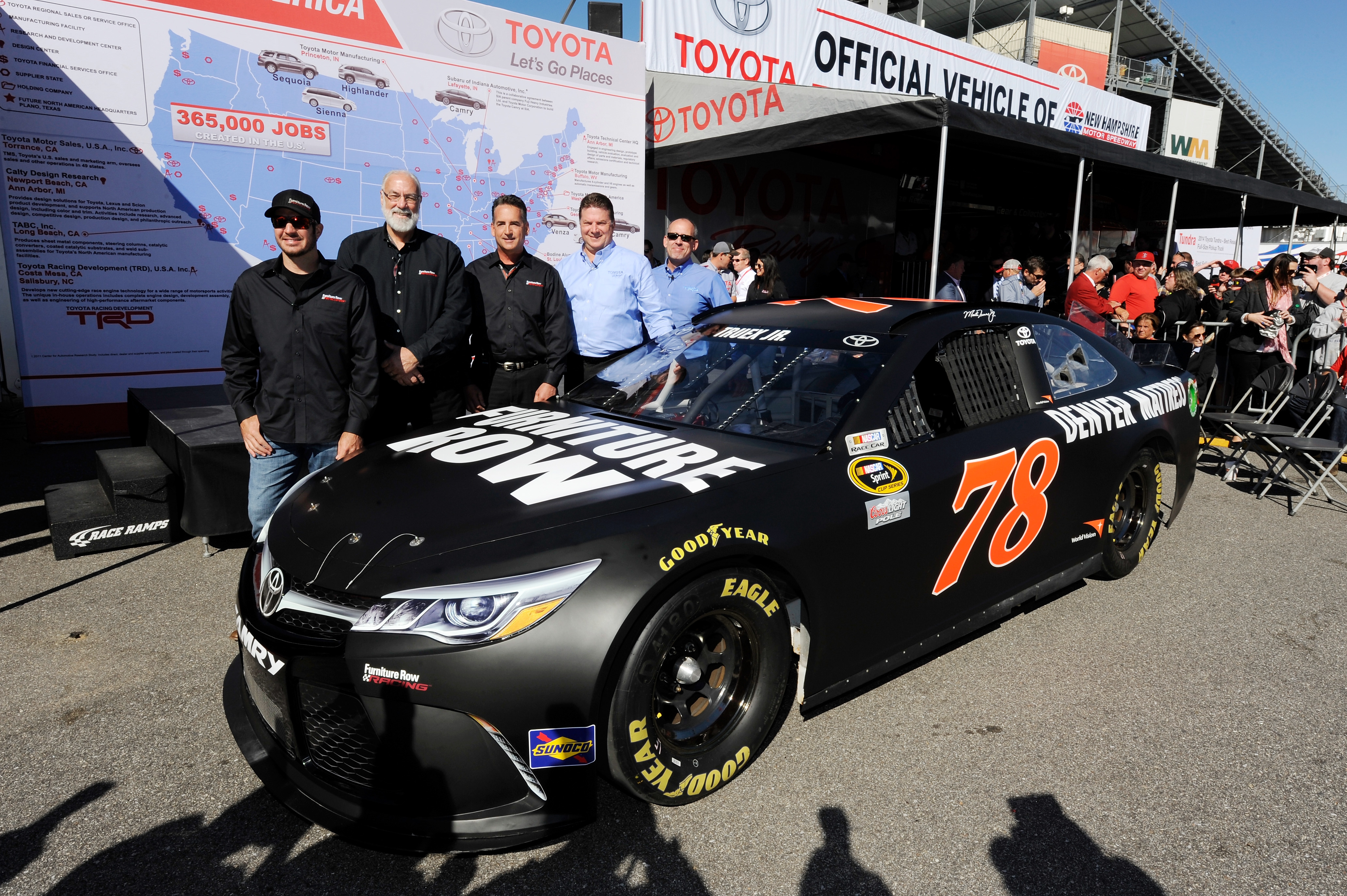 Martin Truex Jr., driver of the #78 Furniture Row/Visser Precision, announces his 2016 partnership with Toyota and technical alliance with Joe Gibbs Racing prior to the NASCAR Sprint Cup Series SYLVANIA 300 at New Hampshire Motor Speedway on September 27, 2015 in Loudon, New Hampshire. (L-R) Martin Truex Jr., driver of the #78 Furniture Row/Visser Precision, Barney Visser, Co-Owner of Furniture Row and Furniture Row Racing, Joe Garone, General Manager of Furniture Row Racing, Edward Laukes, Vice President of Marketing Communications and Motorsports for Toyota USA, and David Wilson, President and General Manager of Toyota Racing Development USA, pose during media availability. (Photo by Jared C. Tilton/Getty Images)