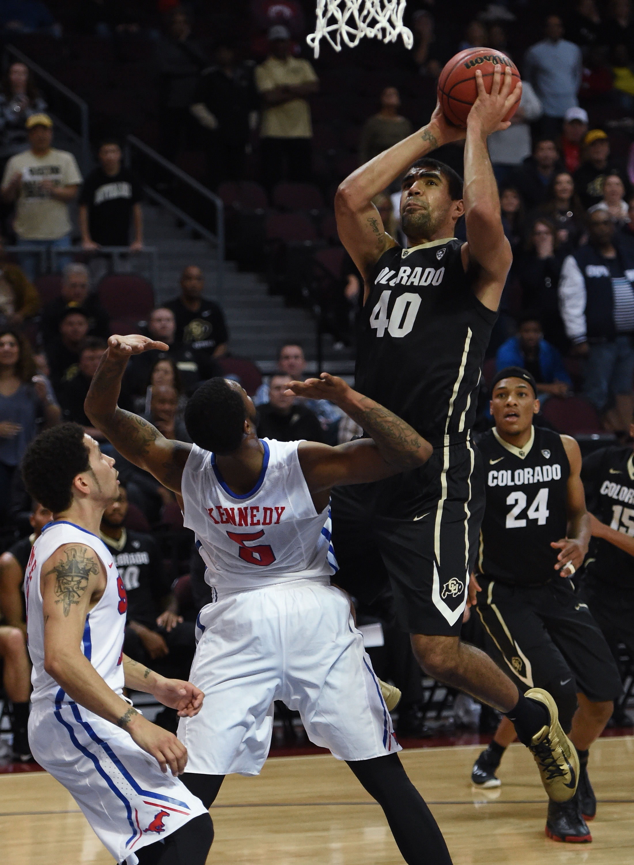 Josh Scott of the Colorado Buffaloes shoots against the Southern Methodist Mustangs during the championship game of the 2015 Continental Tire Las Vegas Classic basketball tournament at the Orleans Arena on Dec. 23, 2015 in Las Vegas. (credit: Ethan Miller/Getty Images)