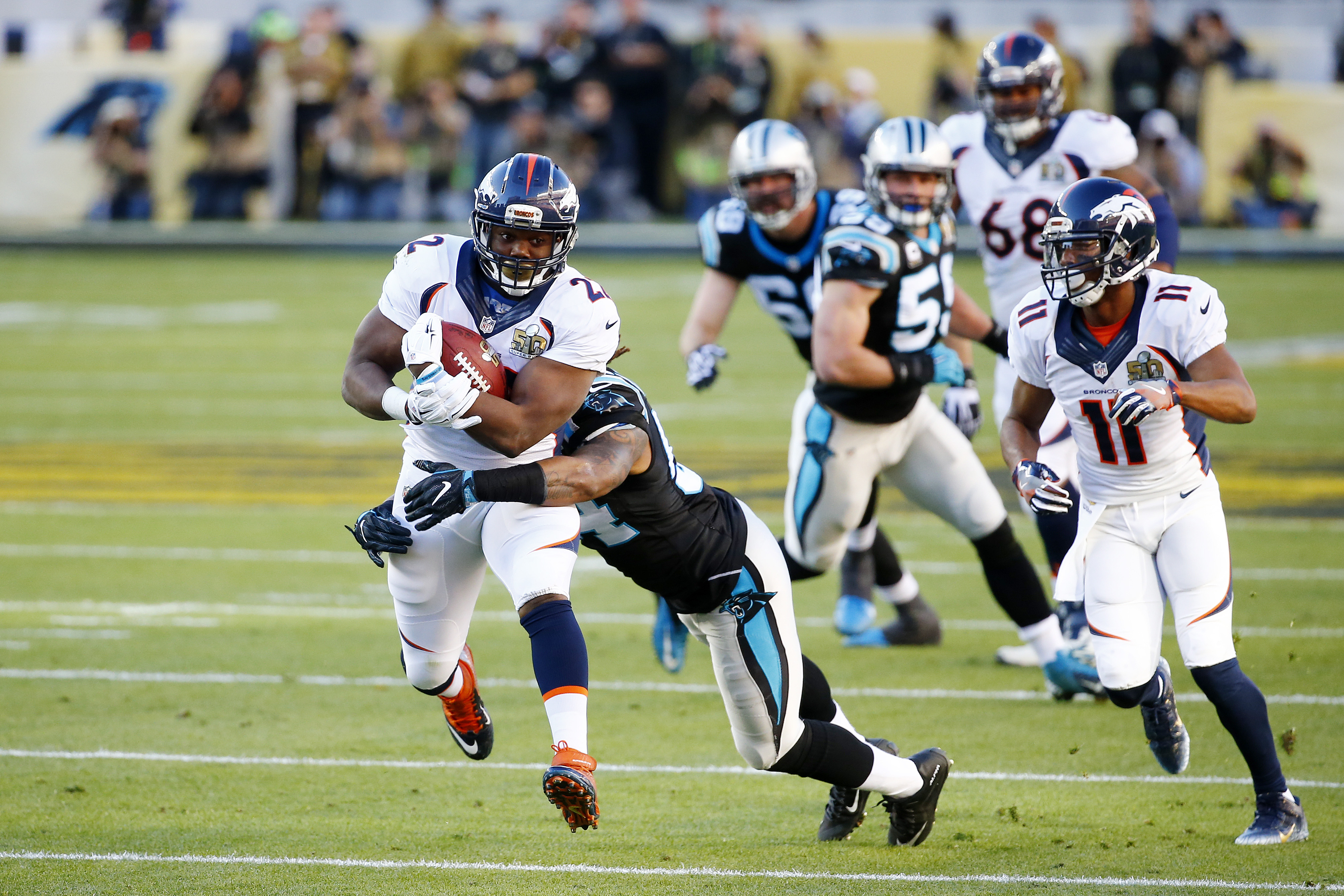 C.J. Anderson #22 of the Denver Broncos runs with the ball in the first quarter against the Carolina Panthers during Super Bowl 50 at Levi's Stadium on February 7, 2016 in Santa Clara, California. (Photo by Al Bello/Getty Images)