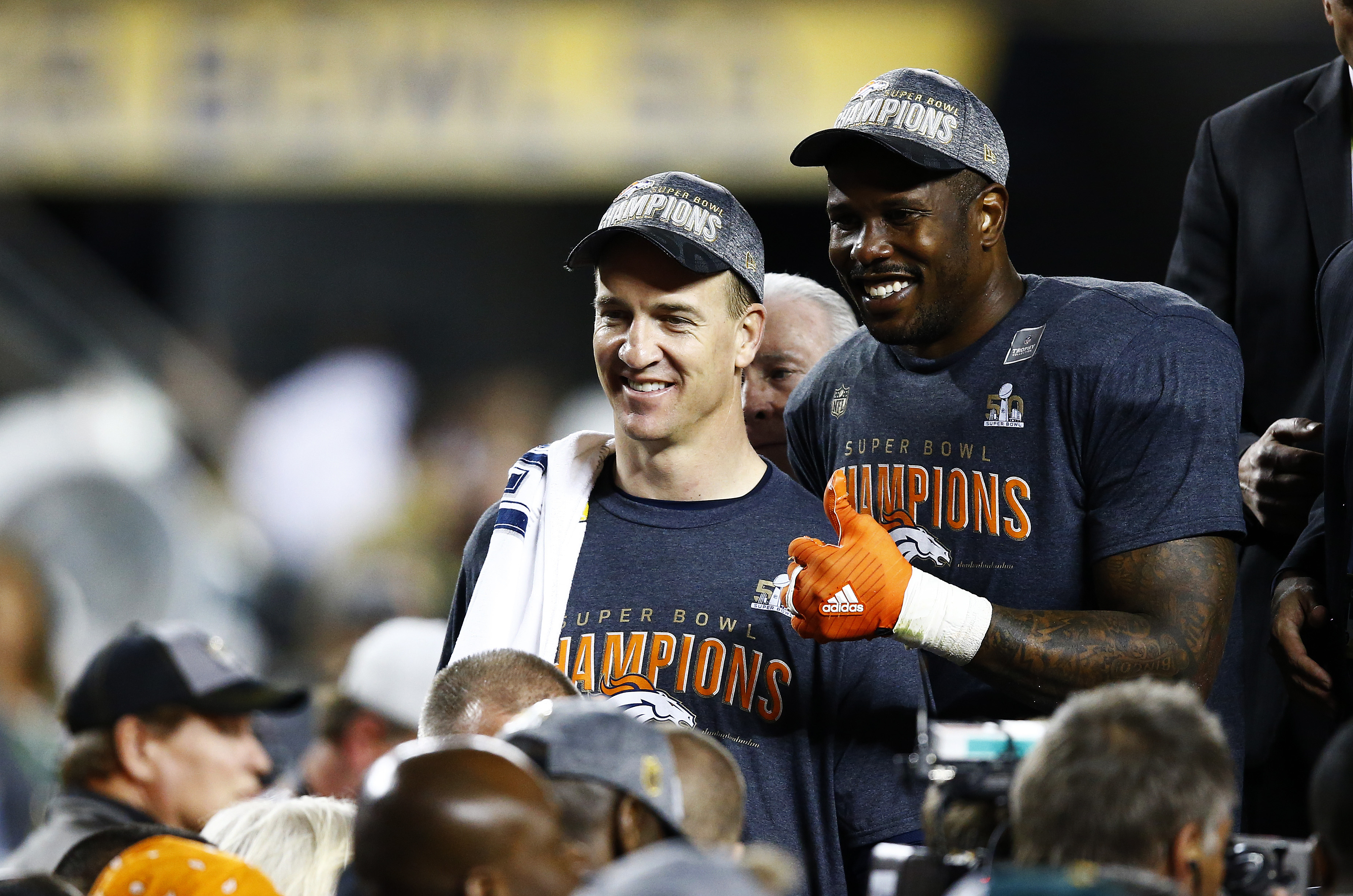 Peyton Manning #18 and Von Miller #58 of the Denver Broncos celebrate after defeating the Carolina Panthers during Super Bowl 50 at Levi's Stadium on February 7, 2016 in Santa Clara, California. The Broncos defeated the Panthers 24-10. (Photo by Al Bello/Getty Images)