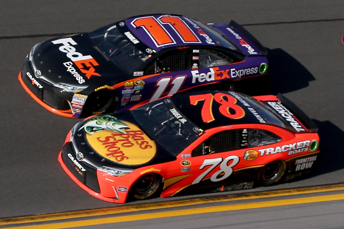 Denny Hamlin, driver of the #11 FedEx Express Toyota, takes the checkered flag ahead of Martin Truex Jr., driver of the #78 Bass Pro Shops/Tracker Boats Toyota, to win the NASCAR Sprint Cup Series DAYTONA 500 at Daytona International Speedway on February 21, 2016 in Daytona Beach, Florida. (Photo by Jonathan Ferrey/Getty Images)