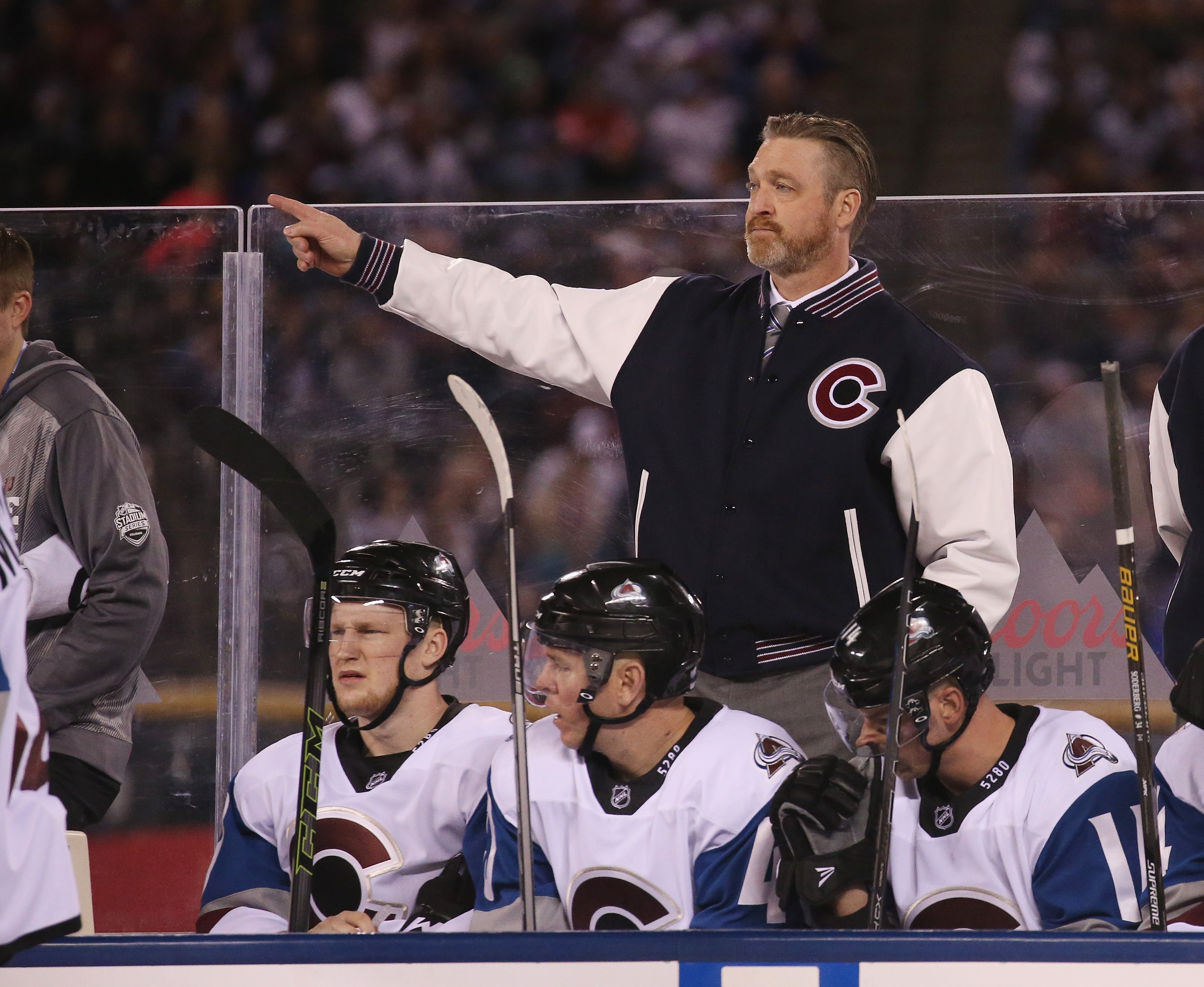 Patrick Roy of the Colorado Avalanche handles bench duties against the Detroit Red Wings at Coors Field during the 2016 Coors Light Stadium Series game on February 27, 2016. (credit: Doug Pensinger/Getty Images)