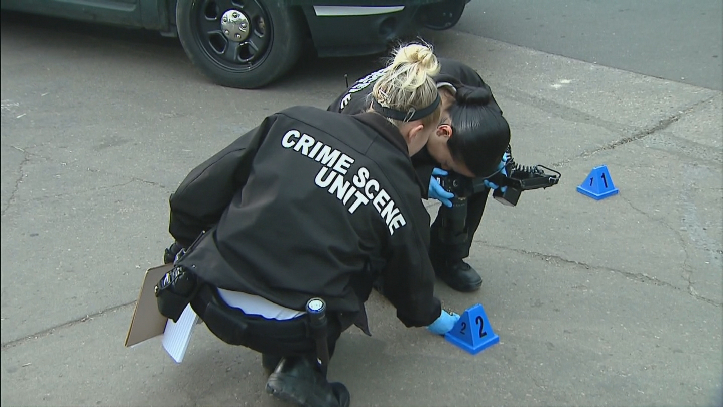Officers investigate a shooting in the Highlands neighborhood on Monday (credit: CBS)