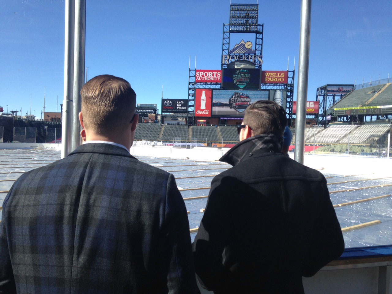 John Mitchell and Matt Duchene check out the rink at Coors Field