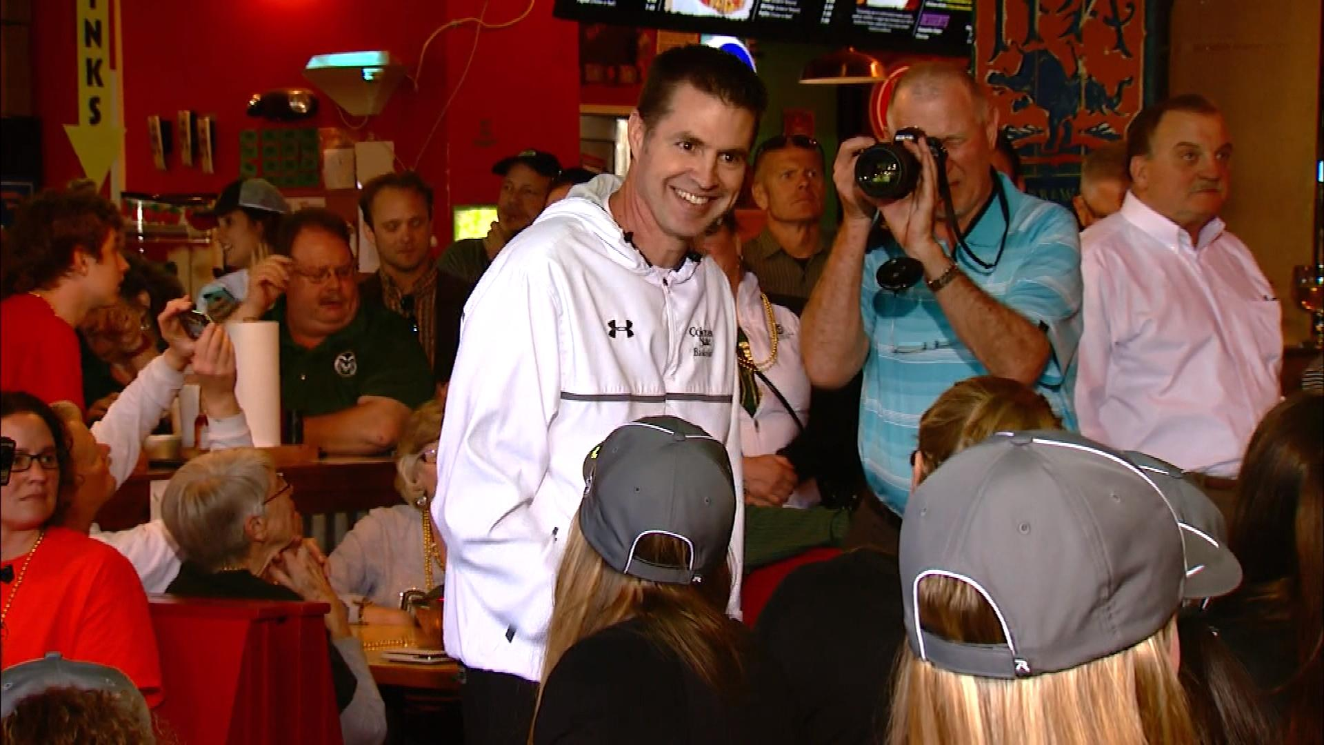 CSU head coach Ryun Williams with his team at the selection show party (credit: CBS)