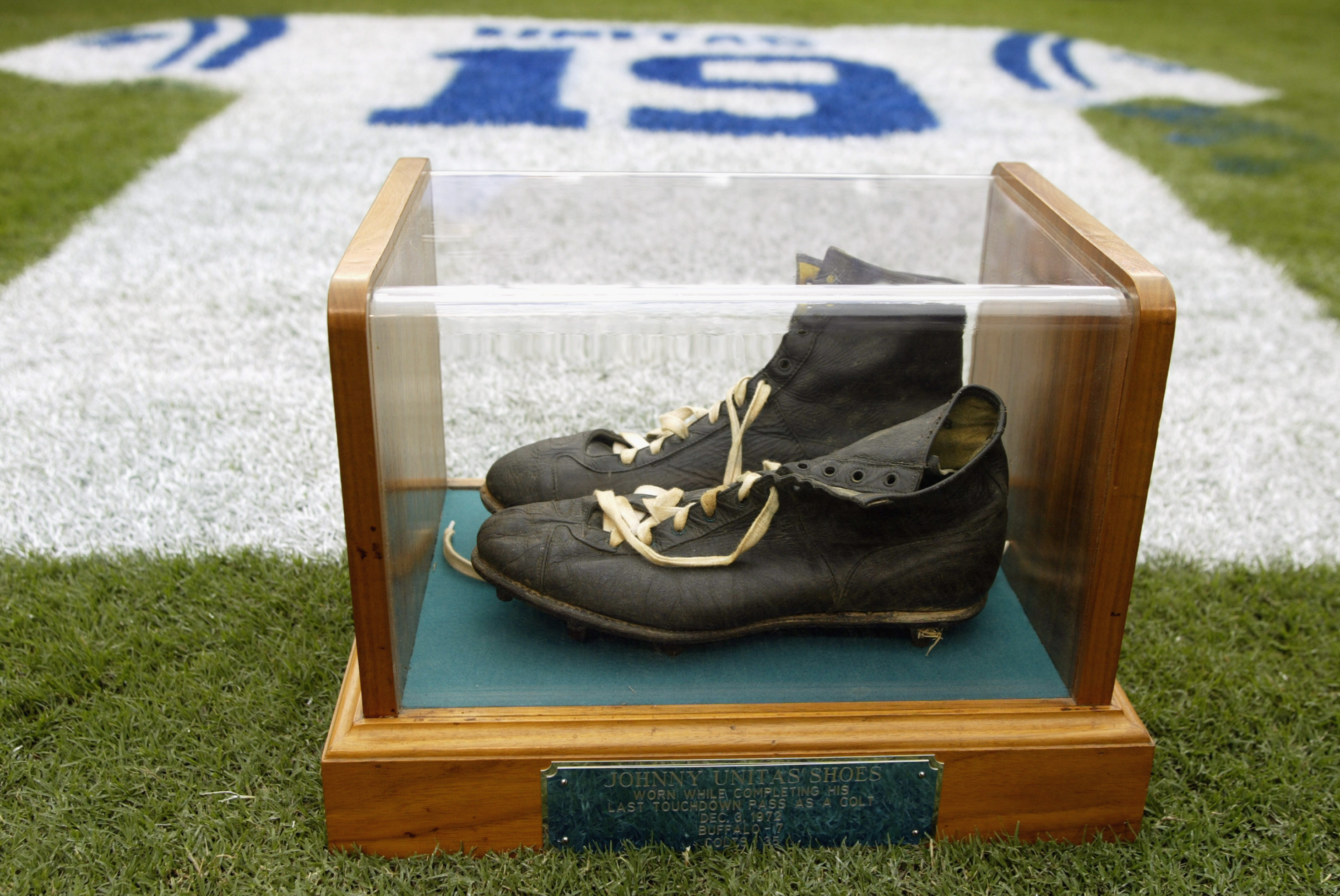 A halftime tribute to Hall of Fame quarterback Johnny Unitas #19 of the Baltimore Colts shows his signature black high tops in a glass case on Sept. 15, 2002 at Ravens Stadium in Baltimore.  (credit: Scott Halleran/Getty Images)