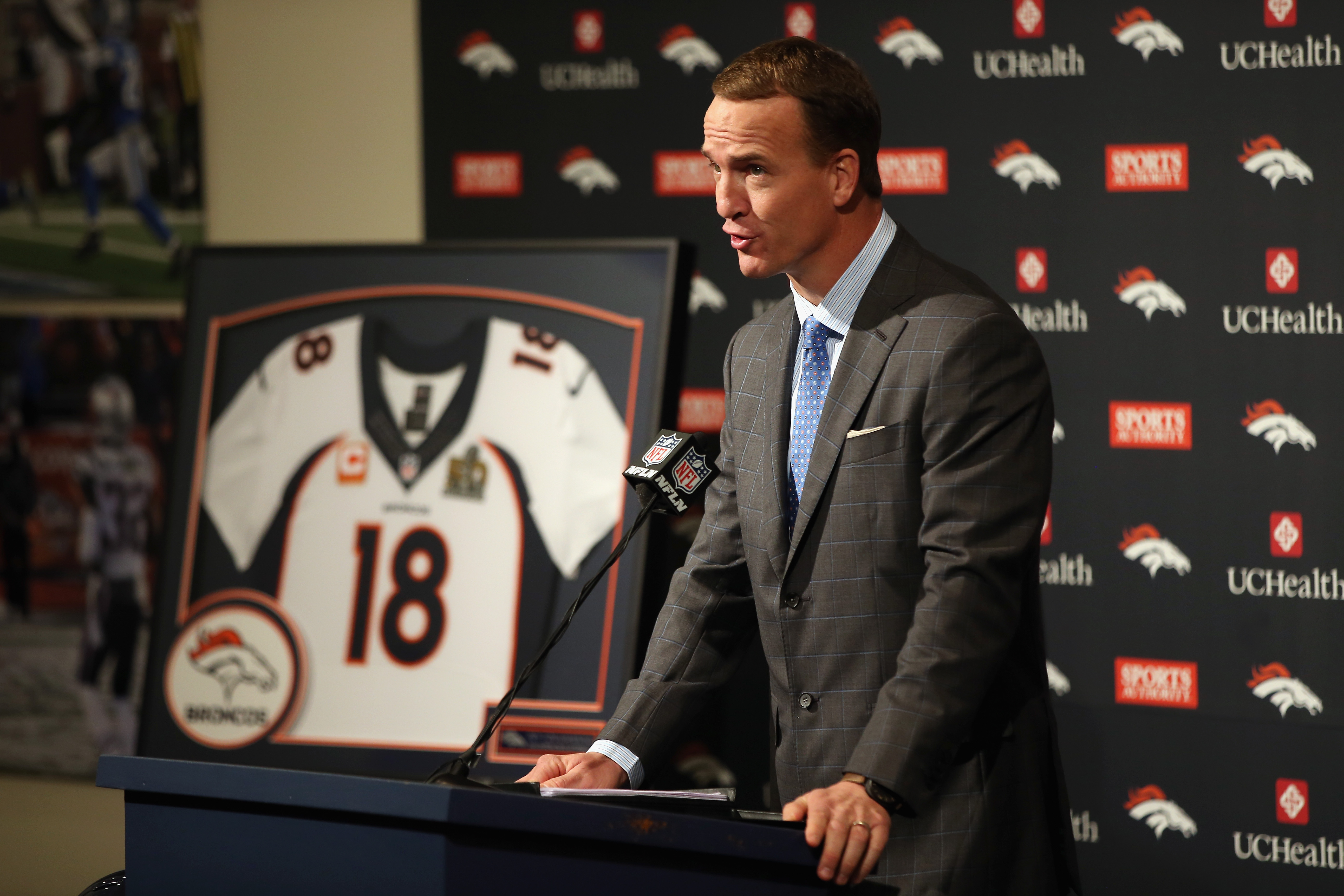 Quarterback Peyton Manning addresses the media as he announces his retirement from the NFL at the UCHealth Training Center on March 7, 2016 in Englewood, Colorado. Manning, who played for both the Indianapolis Colts and Denver Broncos in a career which spanned 18 years, is the NFL's all-time leader in passing touchdowns (539), passing yards (71,940) and tied for regular season QB wins (186). Manning played his final game last month as the winning quarterback in Super Bowl 50 in which the Broncos defeated the Carolina Panthers, earning Manning his second Super Bowl title. (Photo by Doug Pensinger/Getty Images)