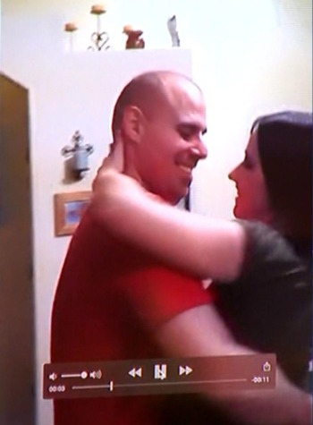 Tom and Ashley Fallis are seen dancing in this video shown during Tom's murder trial. (credit: CBS)