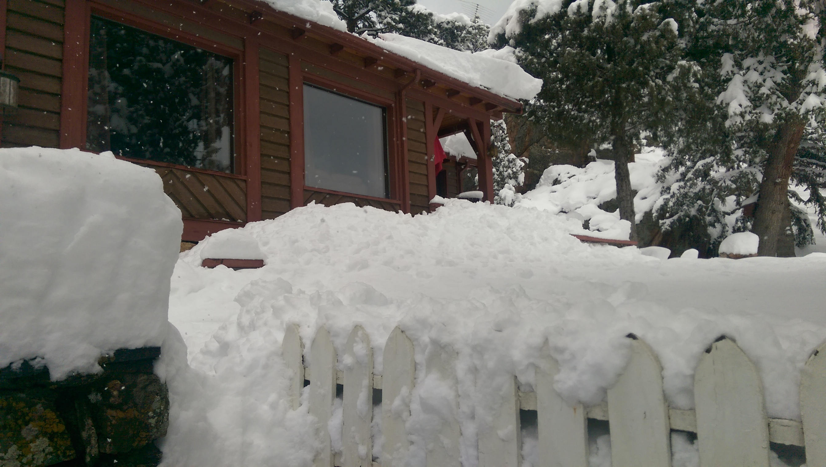 """""""Guess we won't be using our front entrance for a while"""" say the Bitterlys in Evergreen after a large dose of snow in April."""