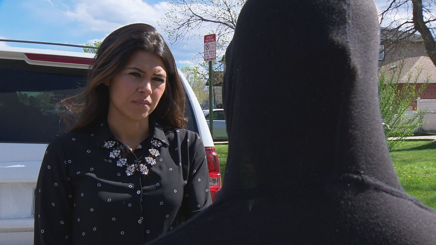 CBS4's Andrea Flores interviews a witness to the shooting in a Sloan's Lake neighborhood (credit: CBS)