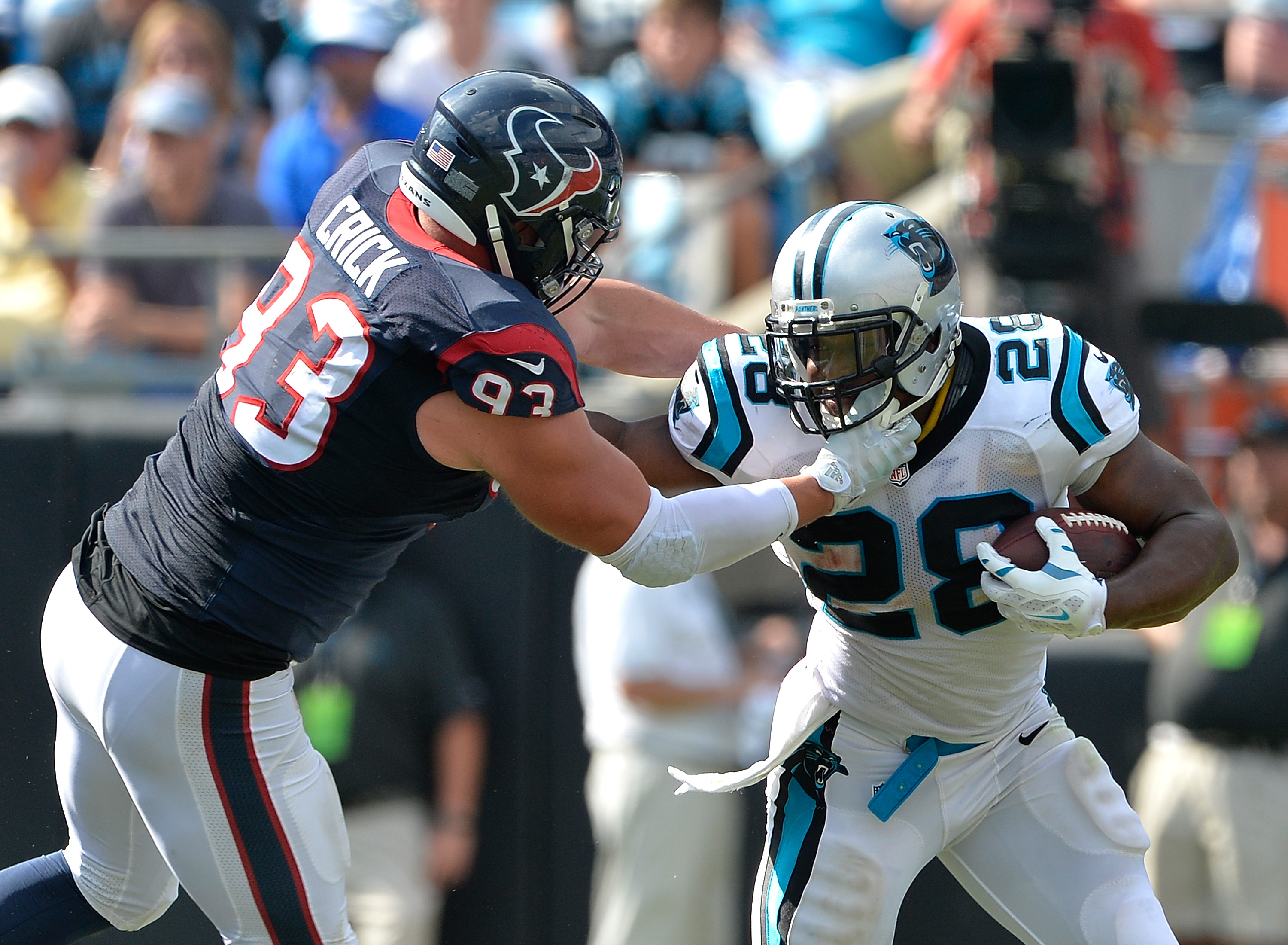 Jared Crick #93 of the Houston Texans tackles Jonathan Stewart #28 of the Carolina Panthers during their game at Bank of America Stadium on September 20, 2015 in Charlotte, North Carolina.  (Photo by Grant Halverson/Getty Images)
