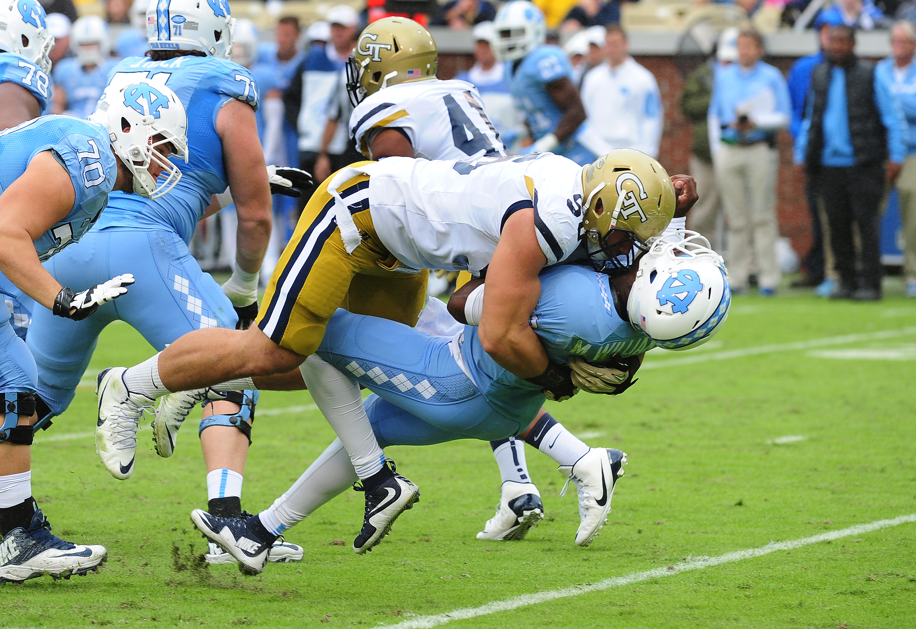 Marquise Williams of the North Carolina Tar Heels takes a hit from Adam Gotsis #96 of the Georgia Tech Yellow Jackets on October 3, 2015 in Atlanta, Georgia. Gotsis would be penalized and ejected from the game for the hit. (credit: Scott Cunningham/Getty Images)
