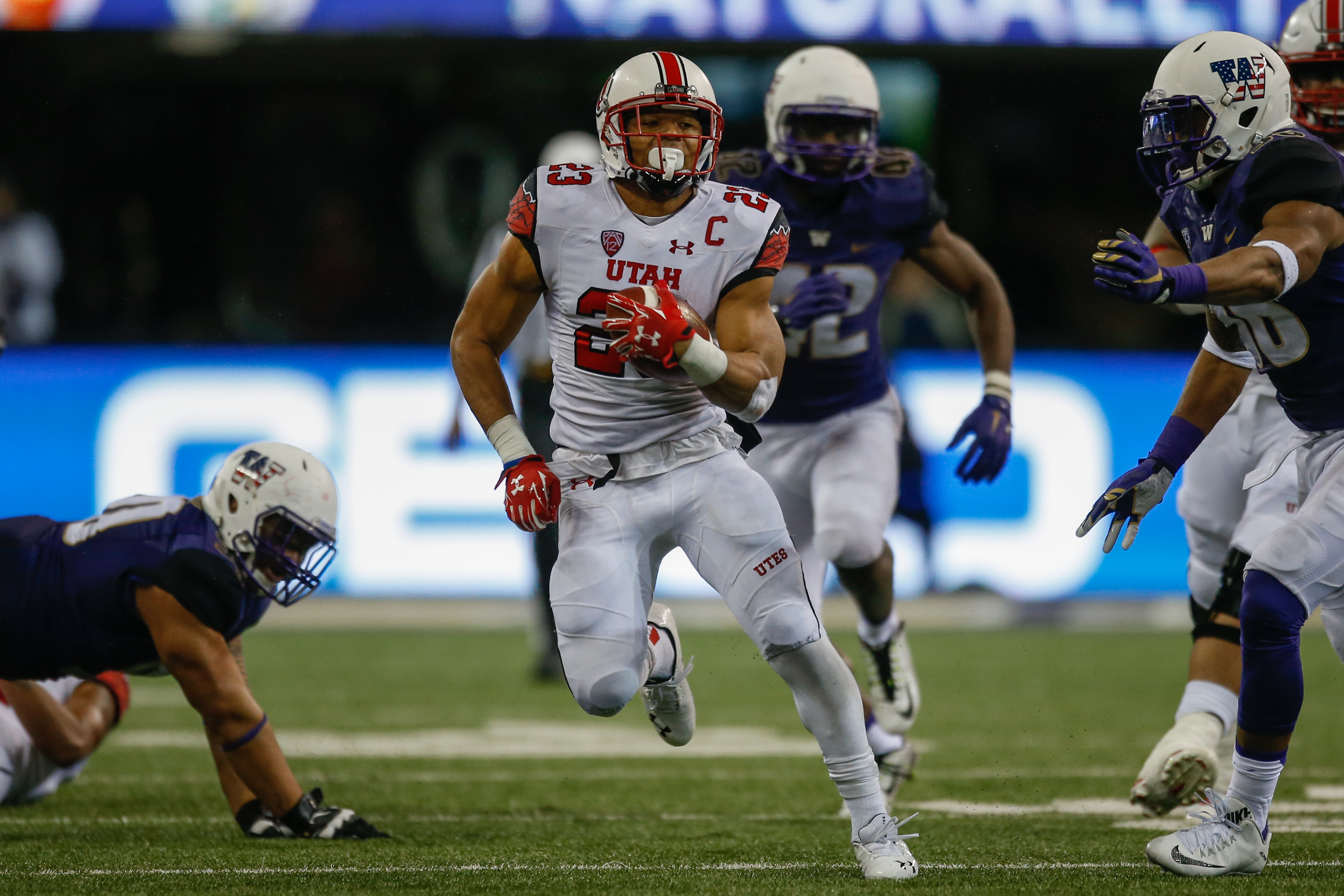 Running back Devontae Booker #23 of the Utah Utes rushes against the Washington Huskies on November 7, 2015 at Husky Stadium in Seattle, Washington. (Photo by Otto Greule Jr/Getty Images)