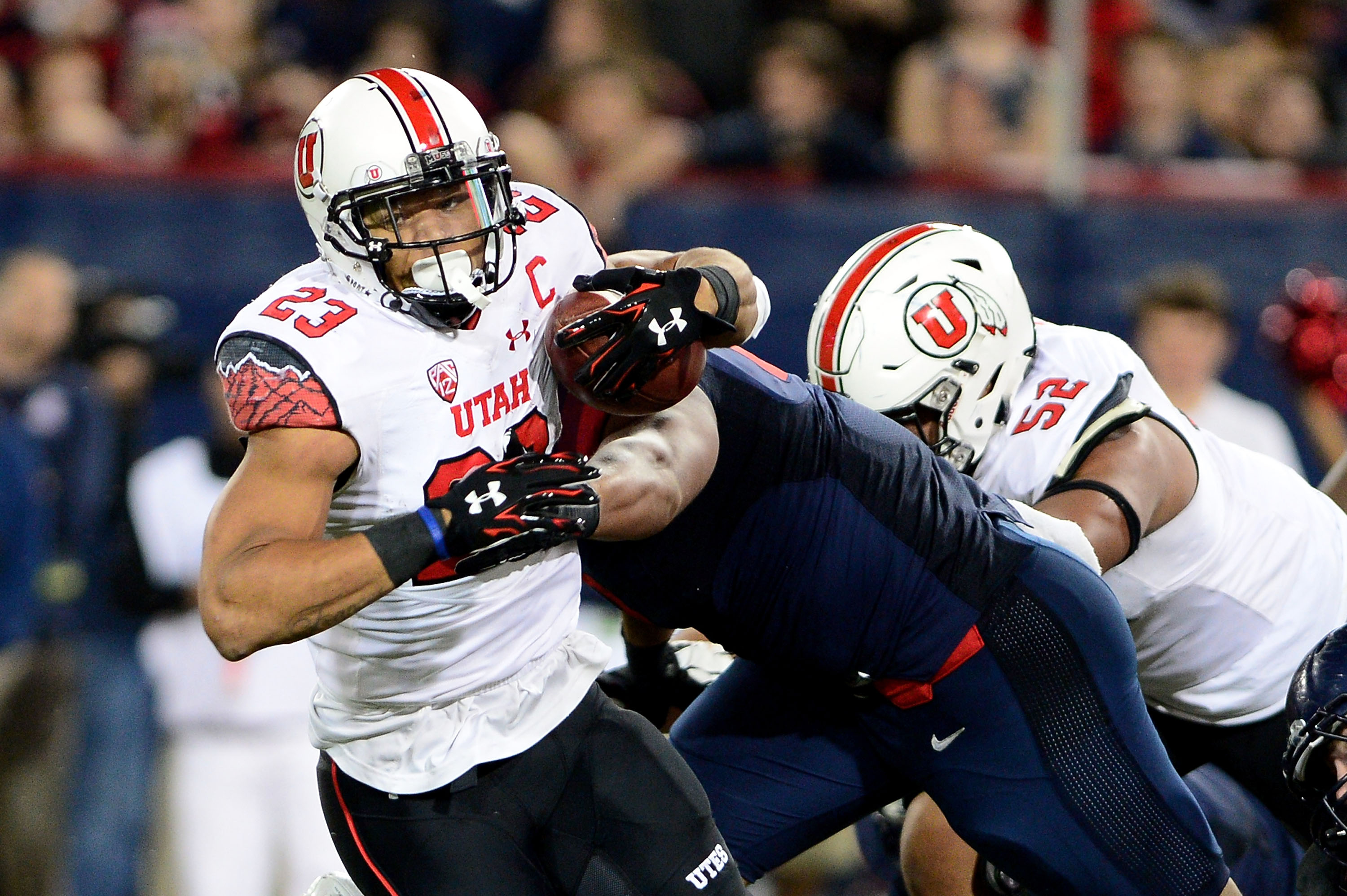 Running back Devontae Booker #23 of the Utah Utes runs with the football against the Arizona Wildcats in the third quarter at Arizona Stadium on November 14, 2015 in Tucson, Arizona. The Wildcats defeated the utes 37-30 in double overtime. (Photo by Jennifer Stewart/Getty Images)