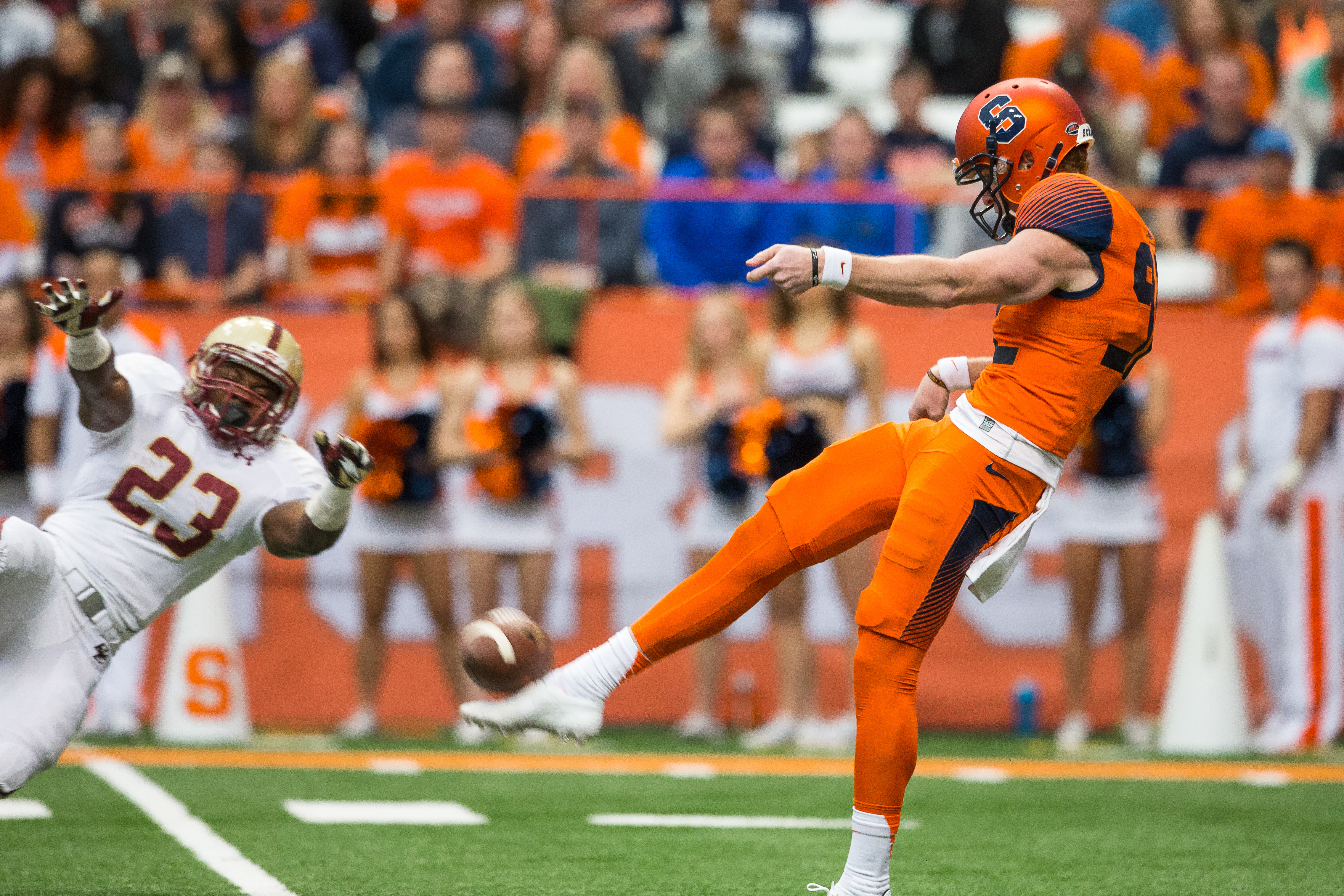 Myles Willis #23 of the Boston College Eagles narrowly misses blocking a punt by Riley Dixon #92 of the Syracuse Orange during the first half on November 28, 2015 at The Carrier Dome in Syracuse, New York. (Photo by Brett Carlsen/Getty Images)