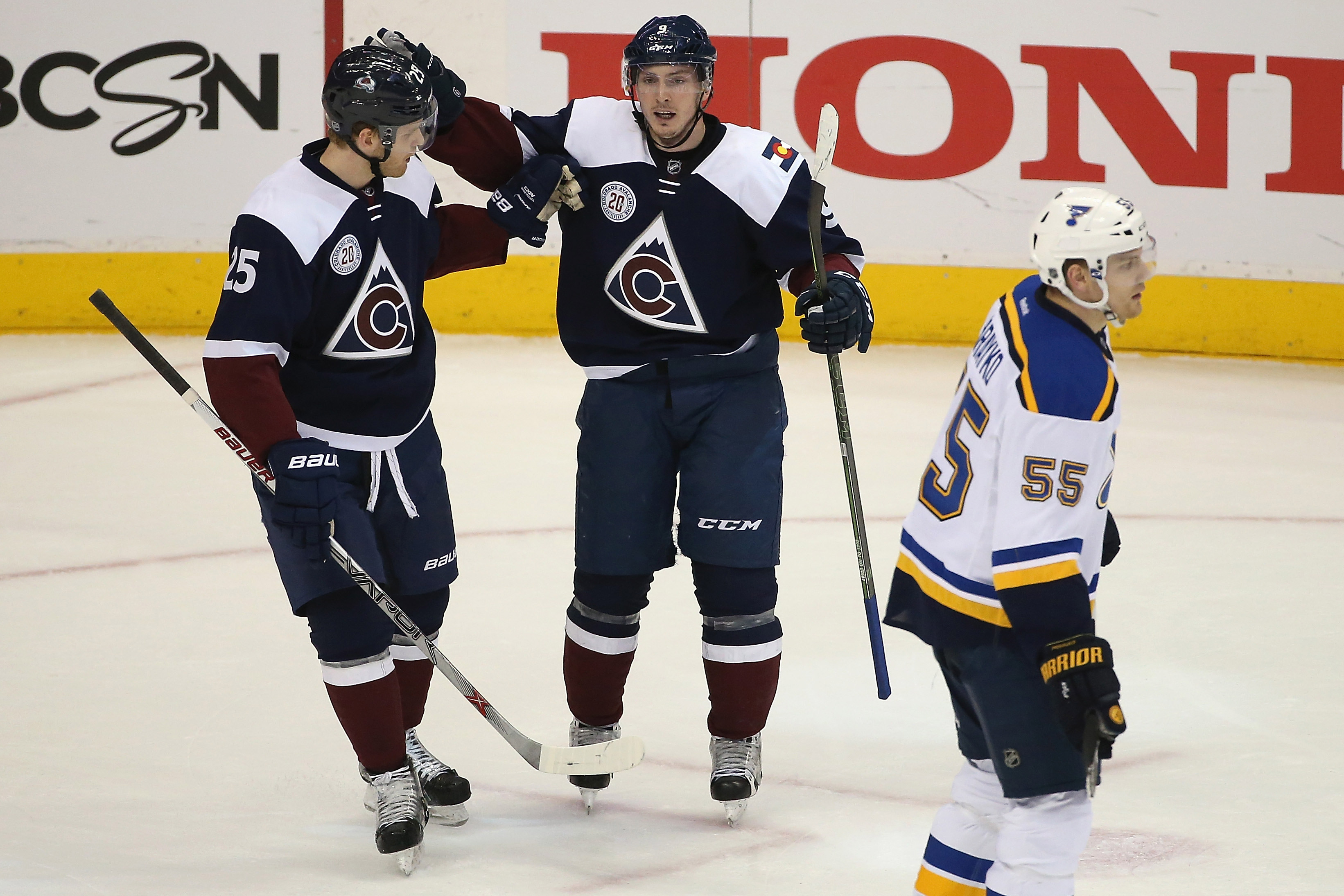 Matt Duchene #9 of the Colorado Avalanche celebrates his goal against the St. Louis Blues with Mikhail Grigorenko #25 of the Colorado Avalanche as Colton Parayko #55 of the St. Louis Blues skates to the bench at Pepsi Center on April 3, 2016 in Denver, Colorado. The Blues defeated the Avalanche 5-1. (Photo by Doug Pensinger/Getty Images)