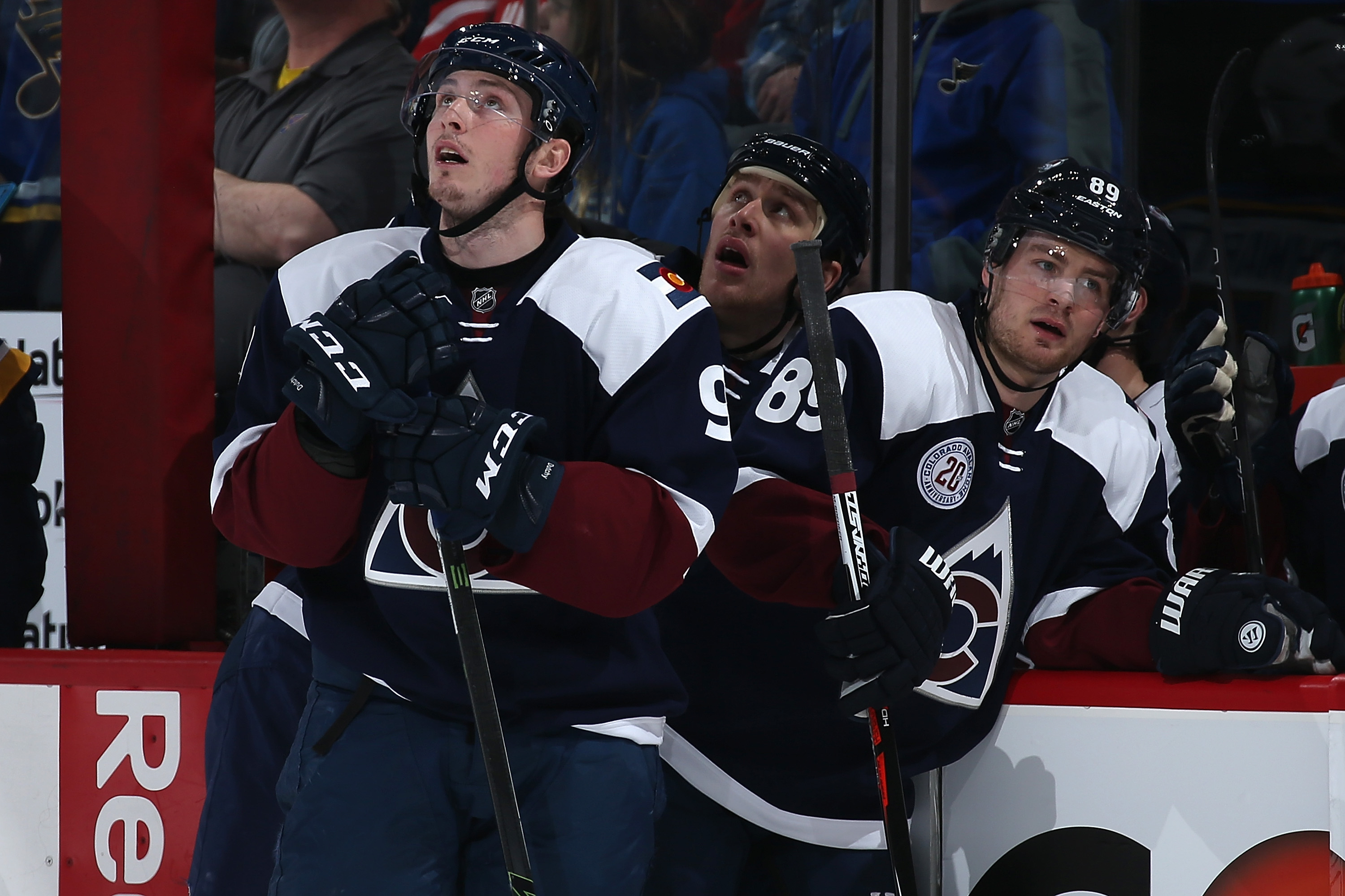 DENVER, COLORADO - APRIL 03: Matt Duchene #9, Shawn Matthias #18 and Mikkel Boedker #89 of the Colorado Avalanche look on as the St. Louis Blues celebrate a goal by Colton Parayko #55 of the St. Louis Blues to take a 3-0 lead in the first period at Pepsi Center on April 3, 2016 in Denver, Colorado. The Blues defeated the Avalanche 5-1. (Photo by Doug Pensinger/Getty Images)