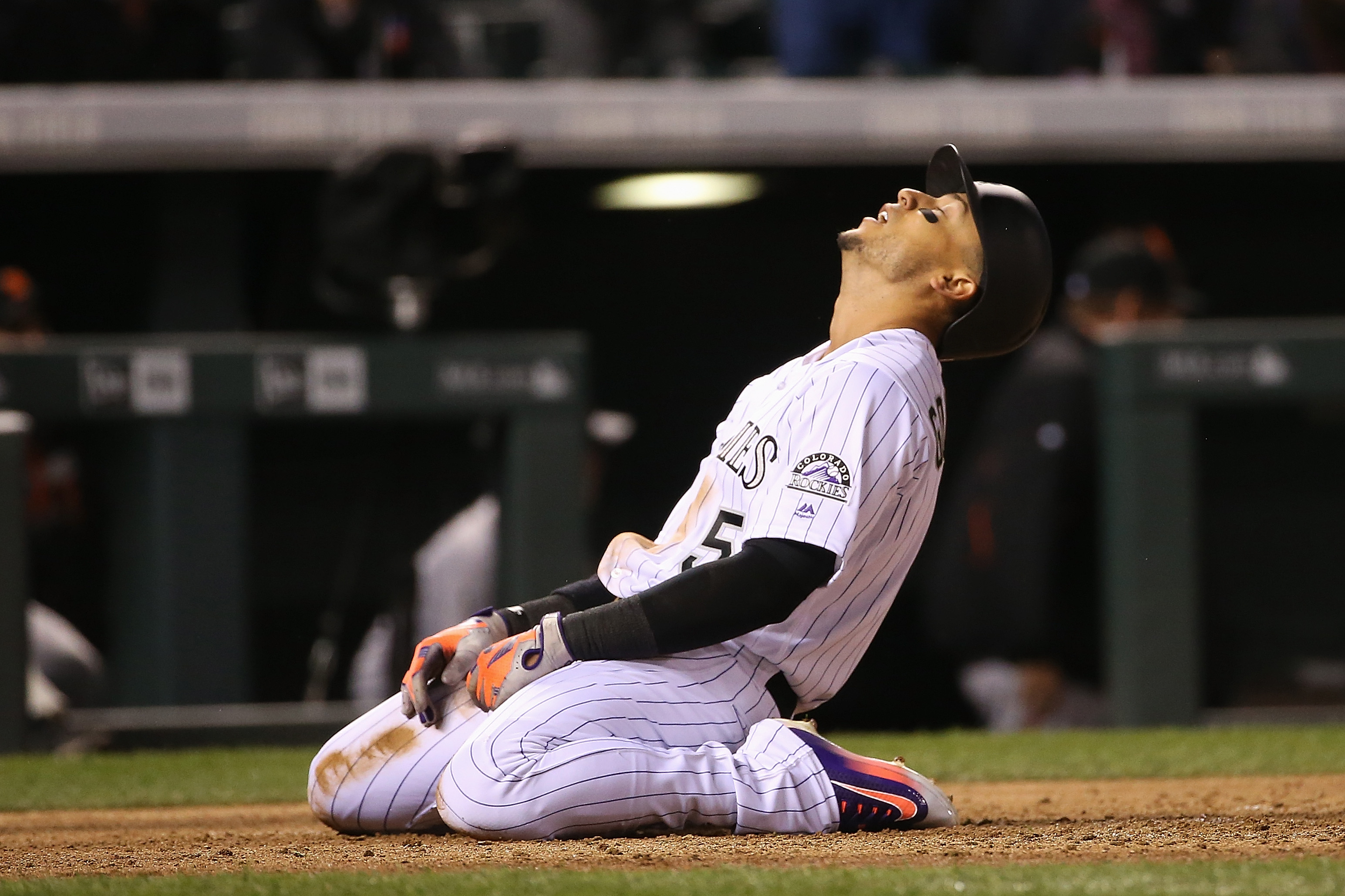 Carlos Gonzalez #5 of the Colorado Rockies reacts after being tagged out at home plate by catcher Trevor Brown #14 of the San Francisco Giants while tying to score on a single by Nolan Arenado #28 of the Colorado Rockies to end the fifth inning at Coors Field on April 12, 2016 in Denver, Colorado. The Giants defeated the Rockies 7-2. (Photo by Doug Pensinger/Getty Images)