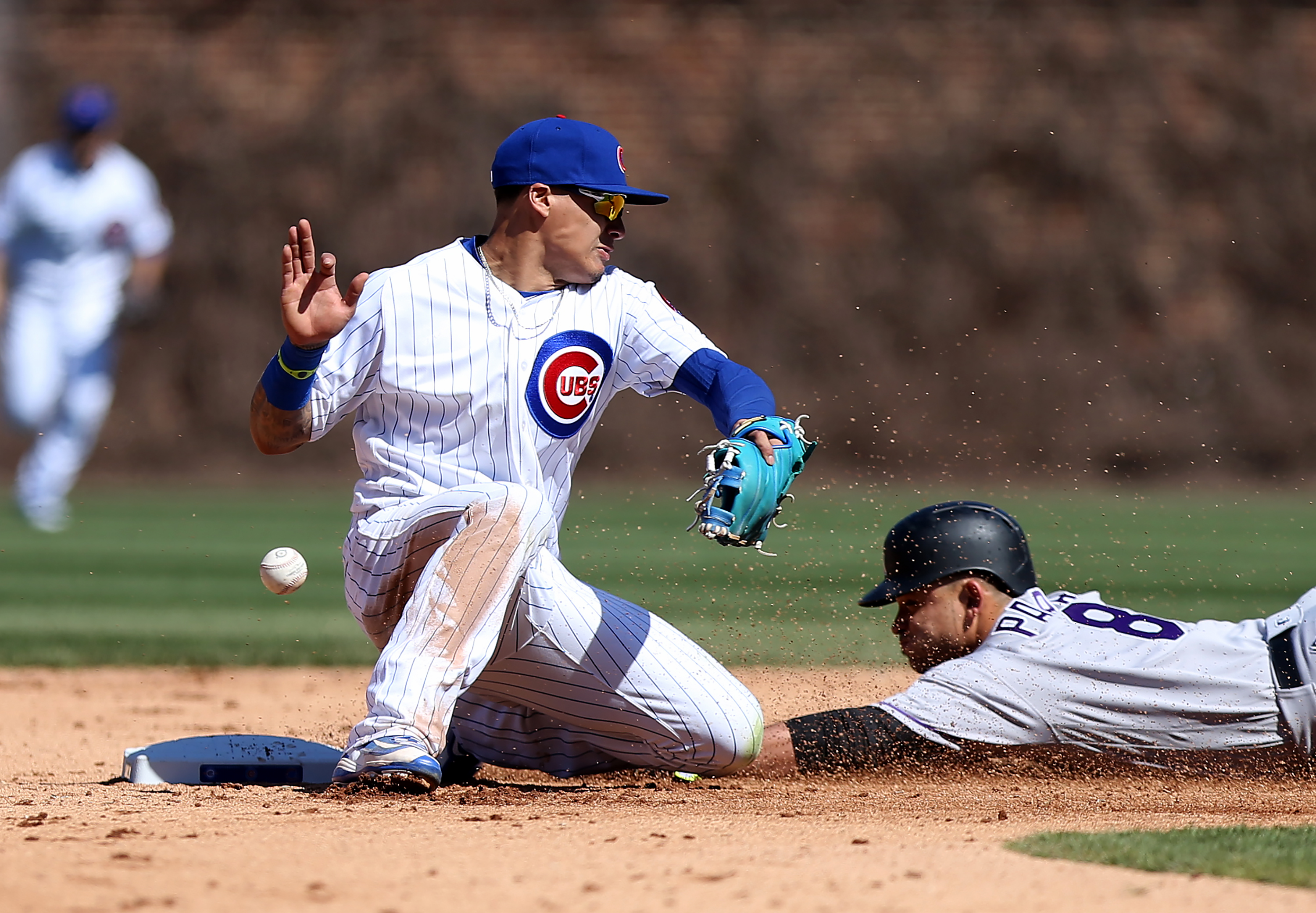 Gerardo Parra #8 of the Colorado Rockies slides into second past Javier Baez #9 of the Chicago Cubs in the seventh inning at Wrigley Field on April 16, 2016 in Chicago, Illinois. (Photo by Dylan Buell/Getty Images)
