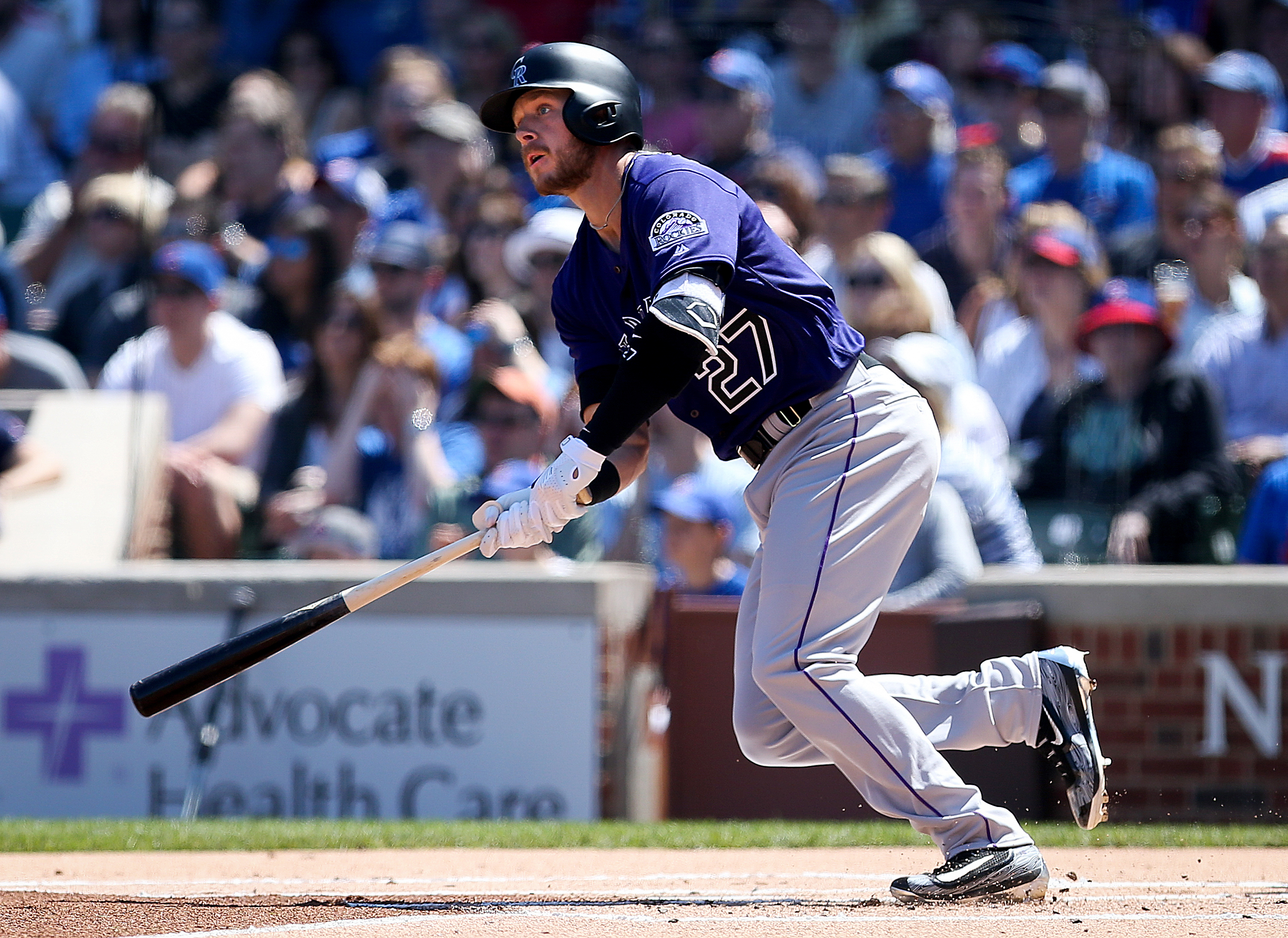Trevor Story of the Colorado Rockies singles in the first inning against the Chicago Cubs at Wrigley Field on April 17, 2016 in Chicago. (Photo by Dylan Buell/Getty Images)