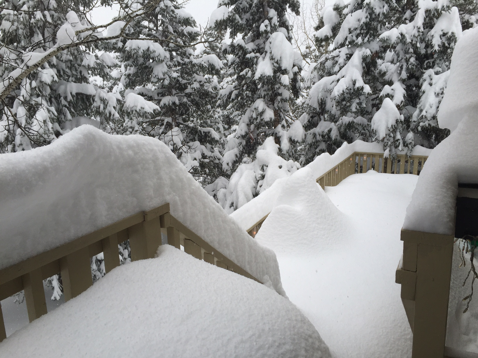 Nearly four feet of snow buries the home of CBS4 YouReporter Brandy Herbert in Conifer during a storm in April 2016.