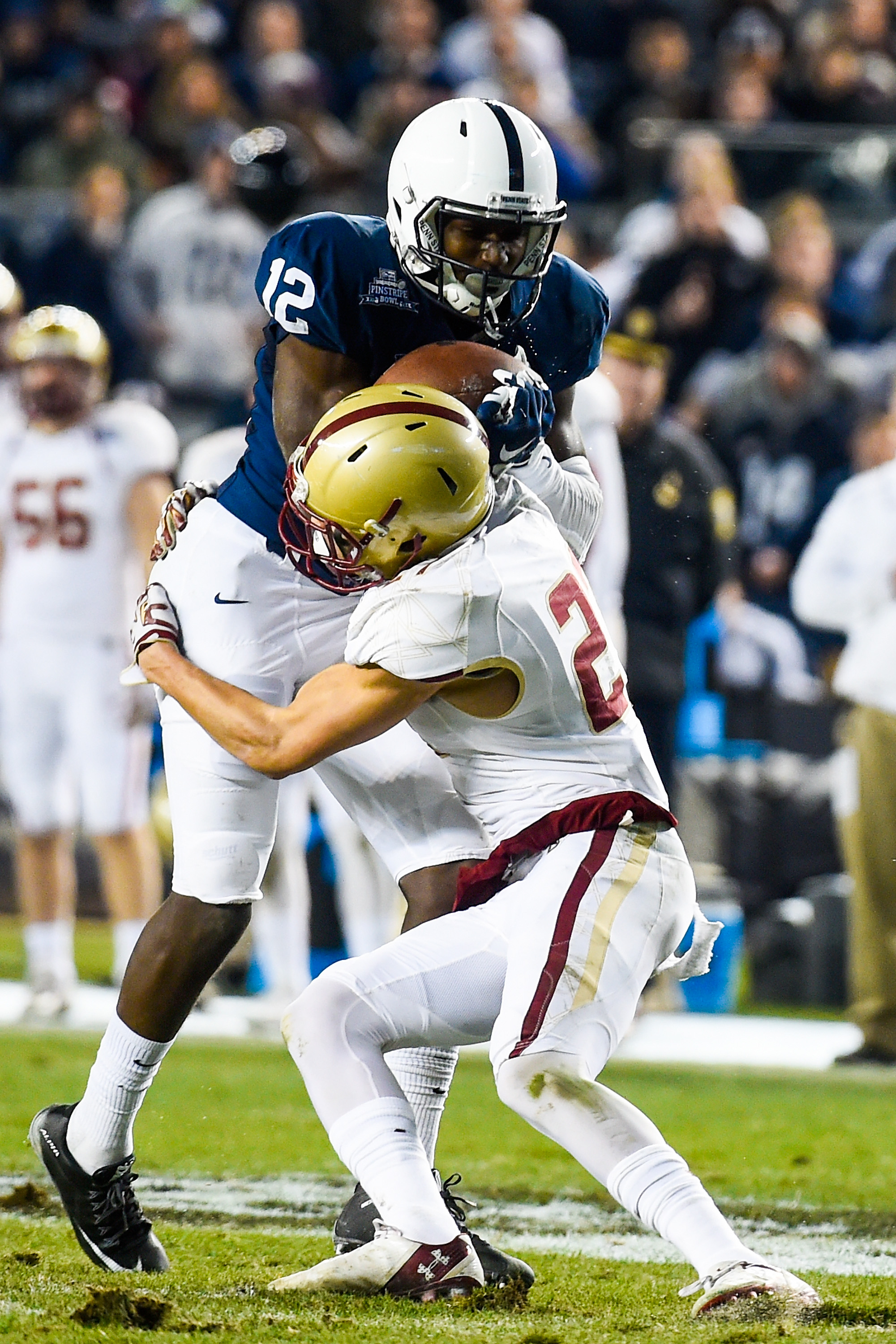 Justin Simmons #27 of the Boston College Eagles stops Chris Godwin #12 of the Penn State Nittany Lions in the first quarter of the 2014 New Era Pinstripe Bowl at Yankee Stadium on December 27, 2014 in the Bronx borough of New York City. (Photo by Alex Goodlett/Getty Images)