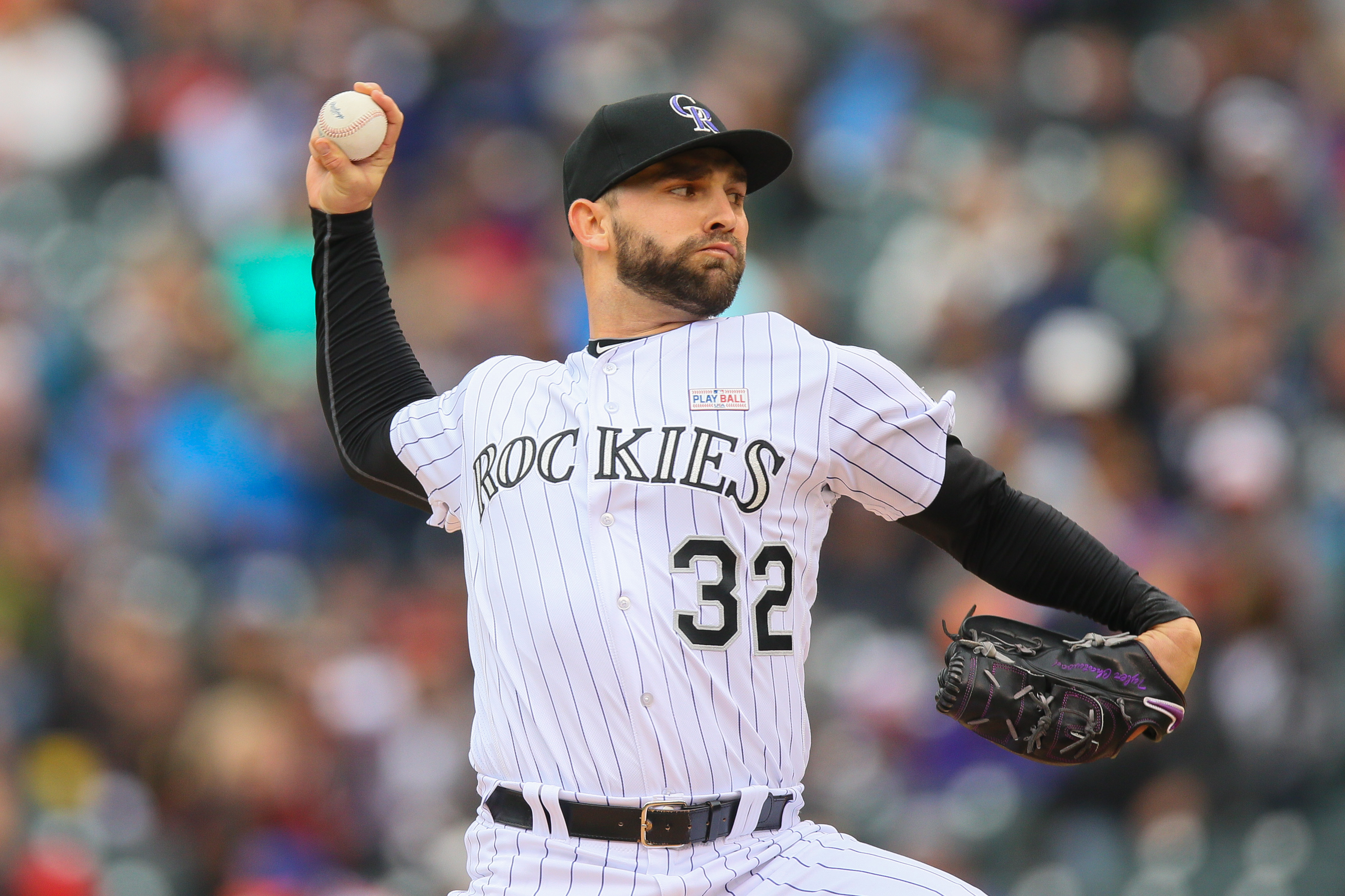 Starting pitcher Tyler Chatwood #32 of the Colorado Rockies delivers to home plate during the first inning against the New York Mets at Coors Field on May 15, 2016 in Denver, Colorado. (Photo by Justin Edmonds/Getty Images)