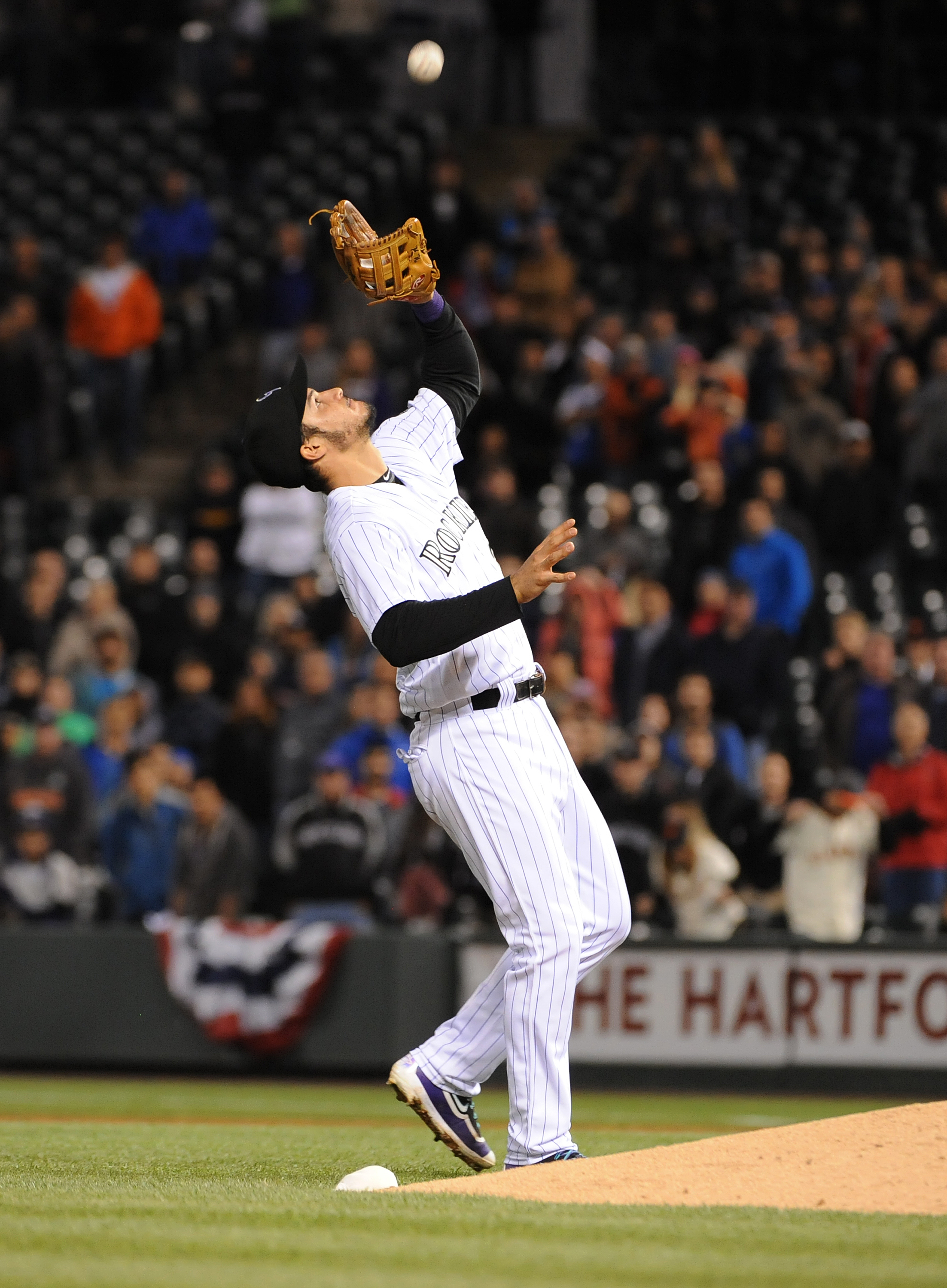 Nolan Arenado of the Colorado Rockies makes the catch for the final out against the San Francisco Giants at Coors Field on May 27, 2016. (credit: Bart Young/Getty Images)
