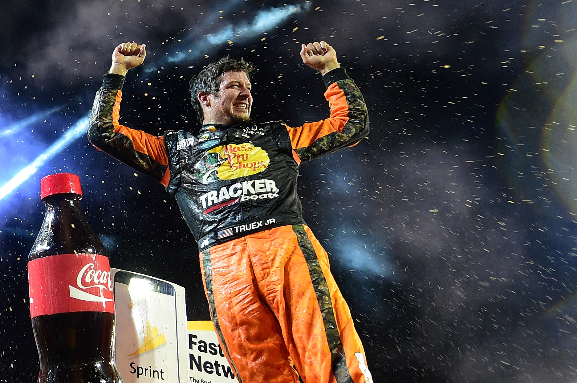 CHARLOTTE, NC - MAY 29: Martin Truex Jr., driver of the #78 Bass Pro Shops/Tracker Toyota, celebrates with champagne in Victory Lane after winning the NASCAR Sprint Cup Series Coca-Cola 600 at Charlotte Motor Speedway on May 29, 2016 in Charlotte, North Carolina. (Photo by Jared C. Tilton/Getty Images)