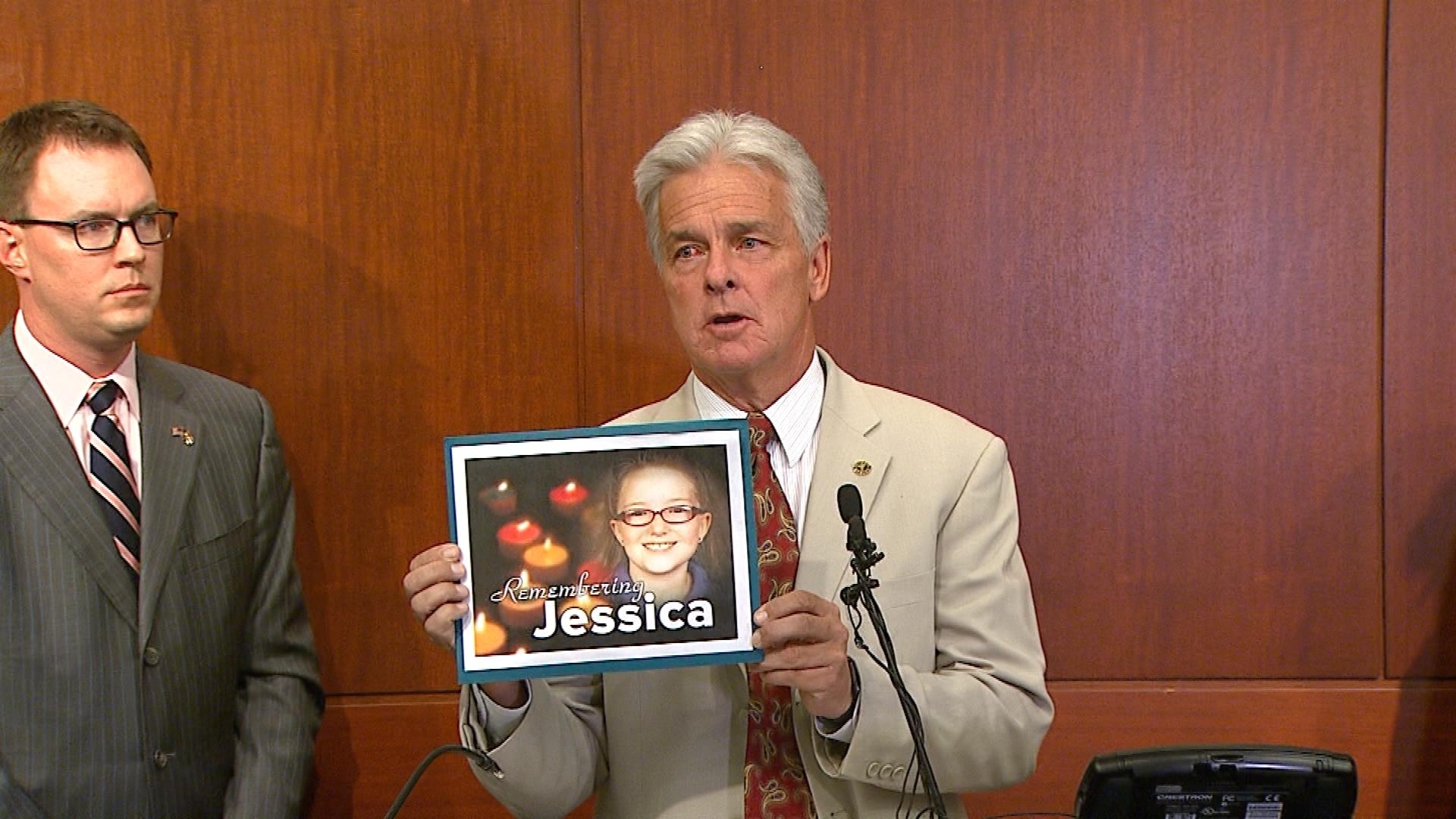 Denver District Attorney Mitch Morrissey holds up a picture of Jessica Ridgeway on Monda (credit: CBS)