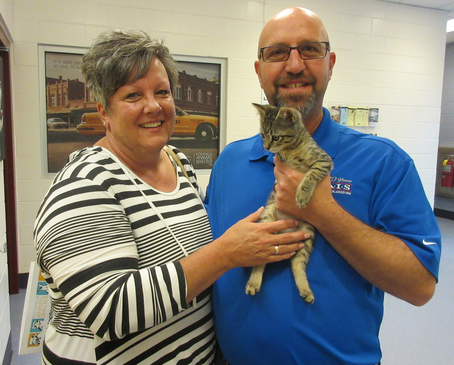 Cindy and Dave with Trooper (credit: foothillsanimalshelter.org)