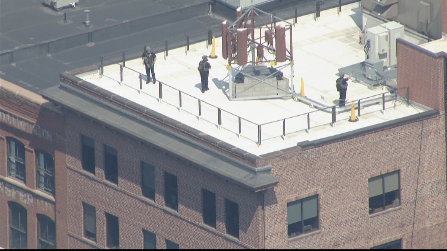 Copter4 flew over a building where officers with guns were stationed on the roof (credit: CBS)
