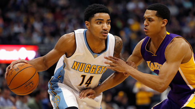 DENVER, CO - MARCH 02: Gary Harris #14 of the Denver Nuggets controls the ball against Jordan Clarkson #6 of the Los Angeles Lakers at Pepsi Center on March 2, 2016 in Denver, Colorado. The Nuggets defeated the Lakers 117-107. (Photo by Doug Pensinger/Getty Images)