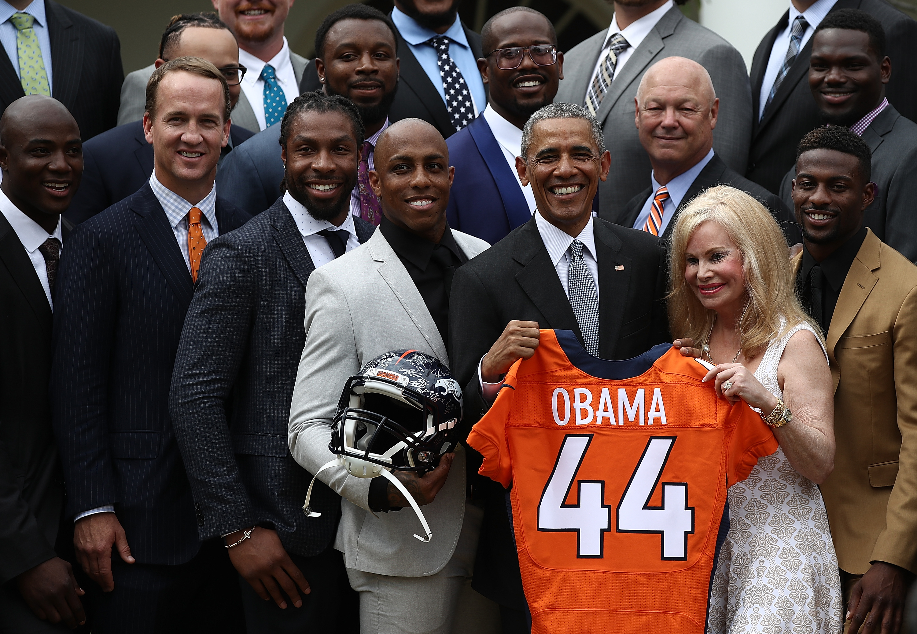 WASHINGTON, DC - JUNE 06: U.S. President Barack Obama holds up a Denver Broncos jersey presented to him as a gift by Annabel Bowlen (R), wife of Broncos majority owner Pat Bowlen, while welcoming the National Football League Super Bowl champion Denver Broncos to the White House Rose Garden on June 6, 2016 in Washington, DC. The Broncos defeated the Carolina Panthers 24-10 in Super Bowl 50. (Photo by Win McNamee/Getty Images)