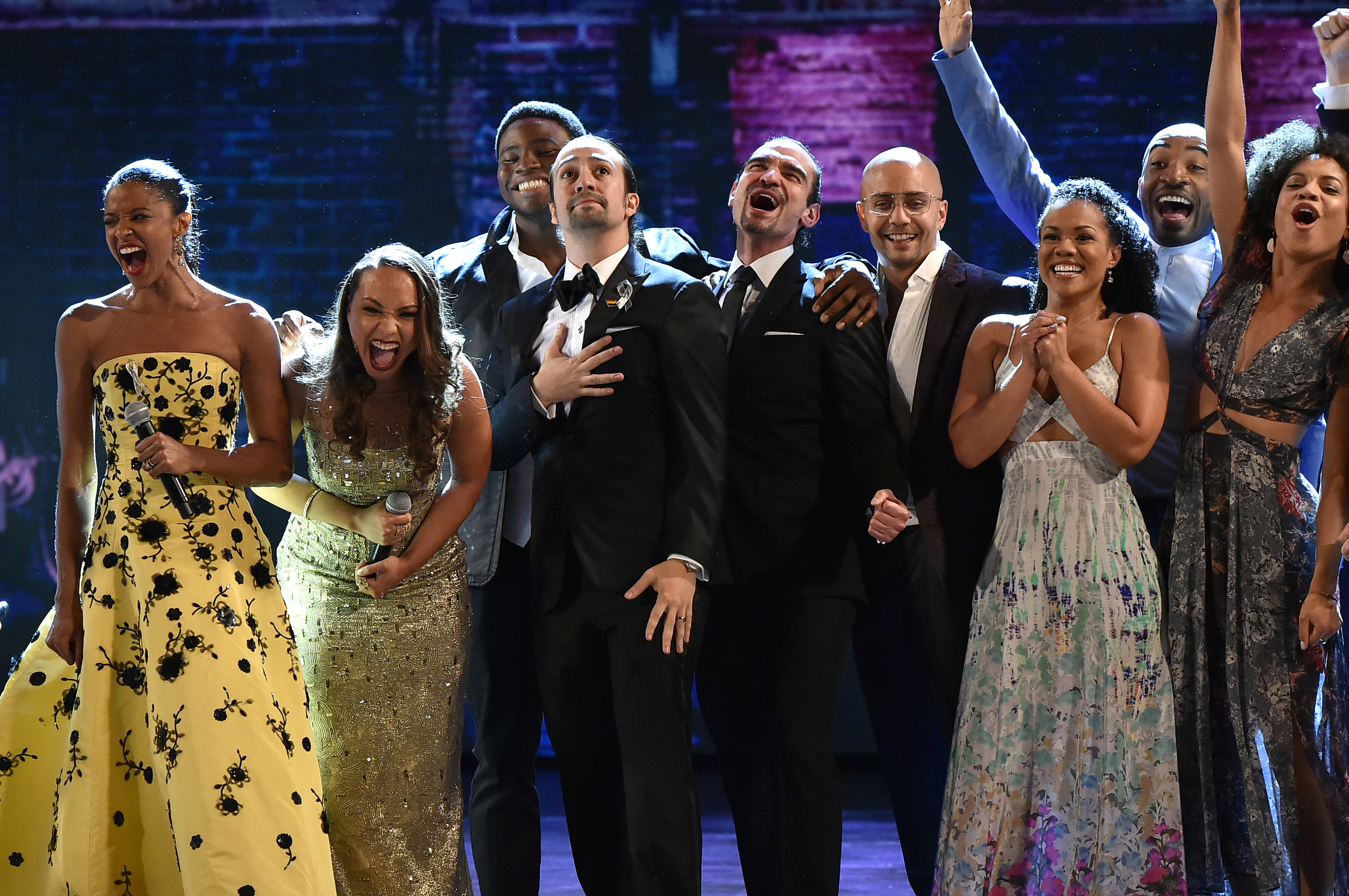 """NEW YORK, NY - JUNE 12: The cast of \""""Hamilton\"""" performs onstage during the 70th Annual Tony Awards at The Beacon Theatre on June 12, 2016 in New York City. (Photo by Theo Wargo/Getty Images for Tony Awards Productions)"""