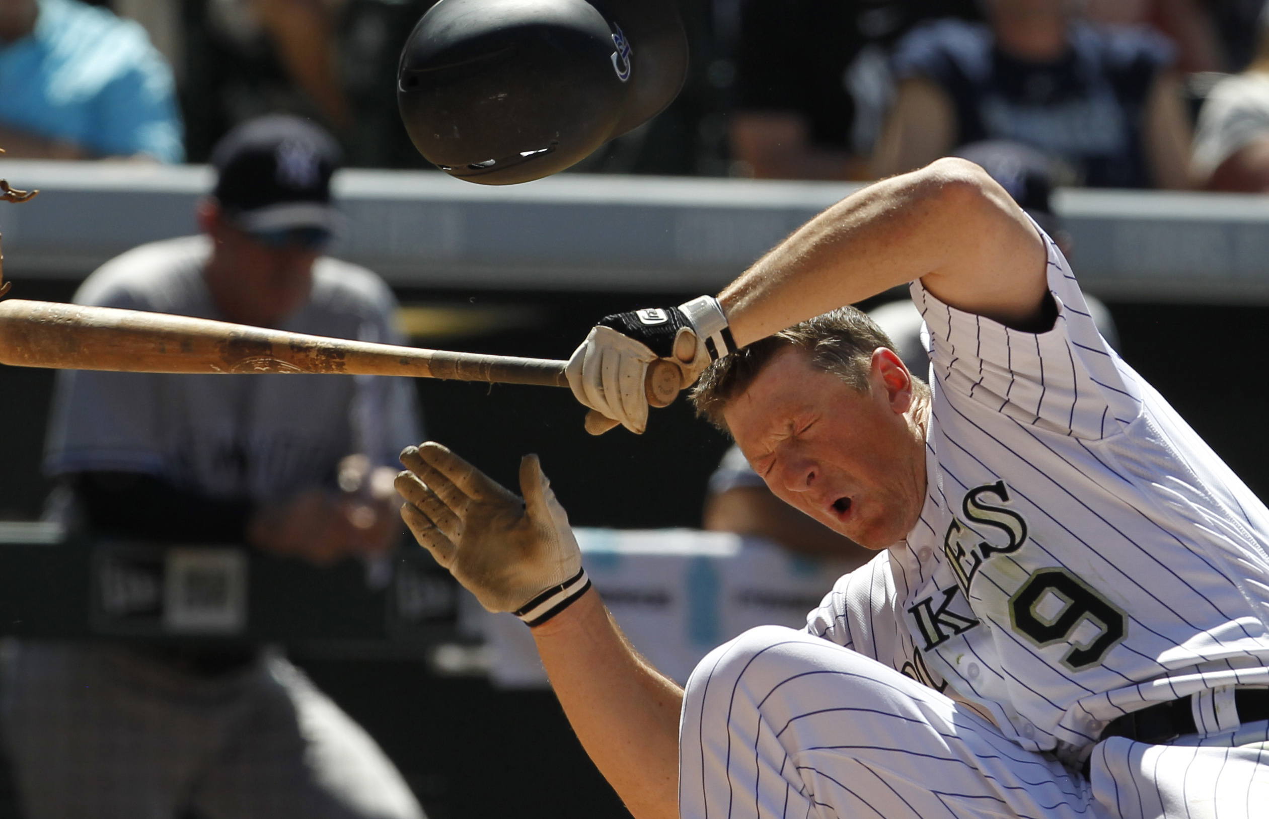 DJ LeMahieu of the Colorado Rockies falls after being hit in the head by a pitch thrown by pitcher Anthony Swarzak #43 of the New York Yankees in the sixth inning at Coors Field on June 15, 2016.(Photo by Joe Mahoney/Getty Images)