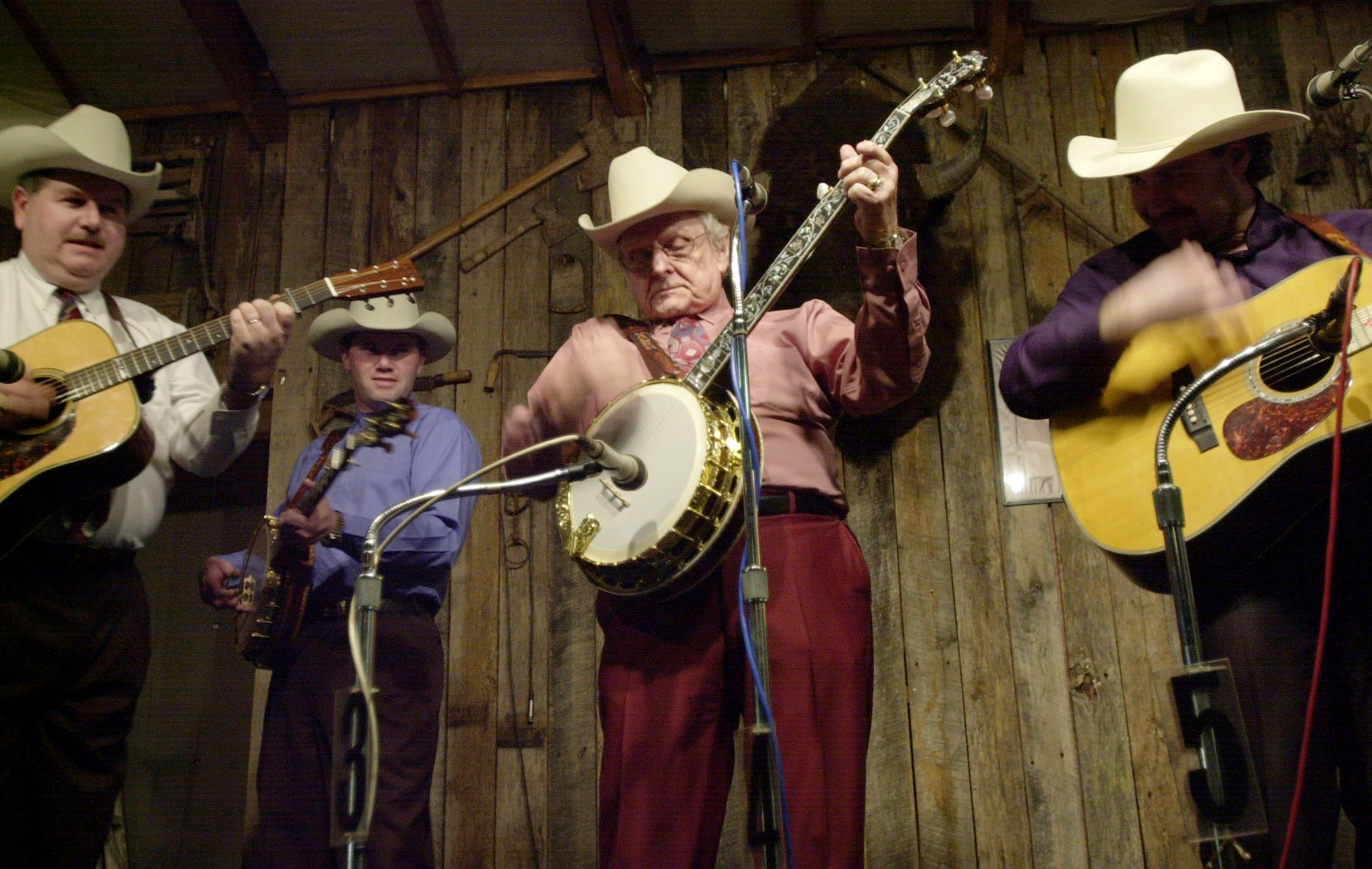 Ralph Stanley and the Clinch Mountain Boys perform on Jan. 5, 2002 at the Meadowgreen Park Bluegrass Music Hall in Clay City, Kentucky. (credit: Getty Images)