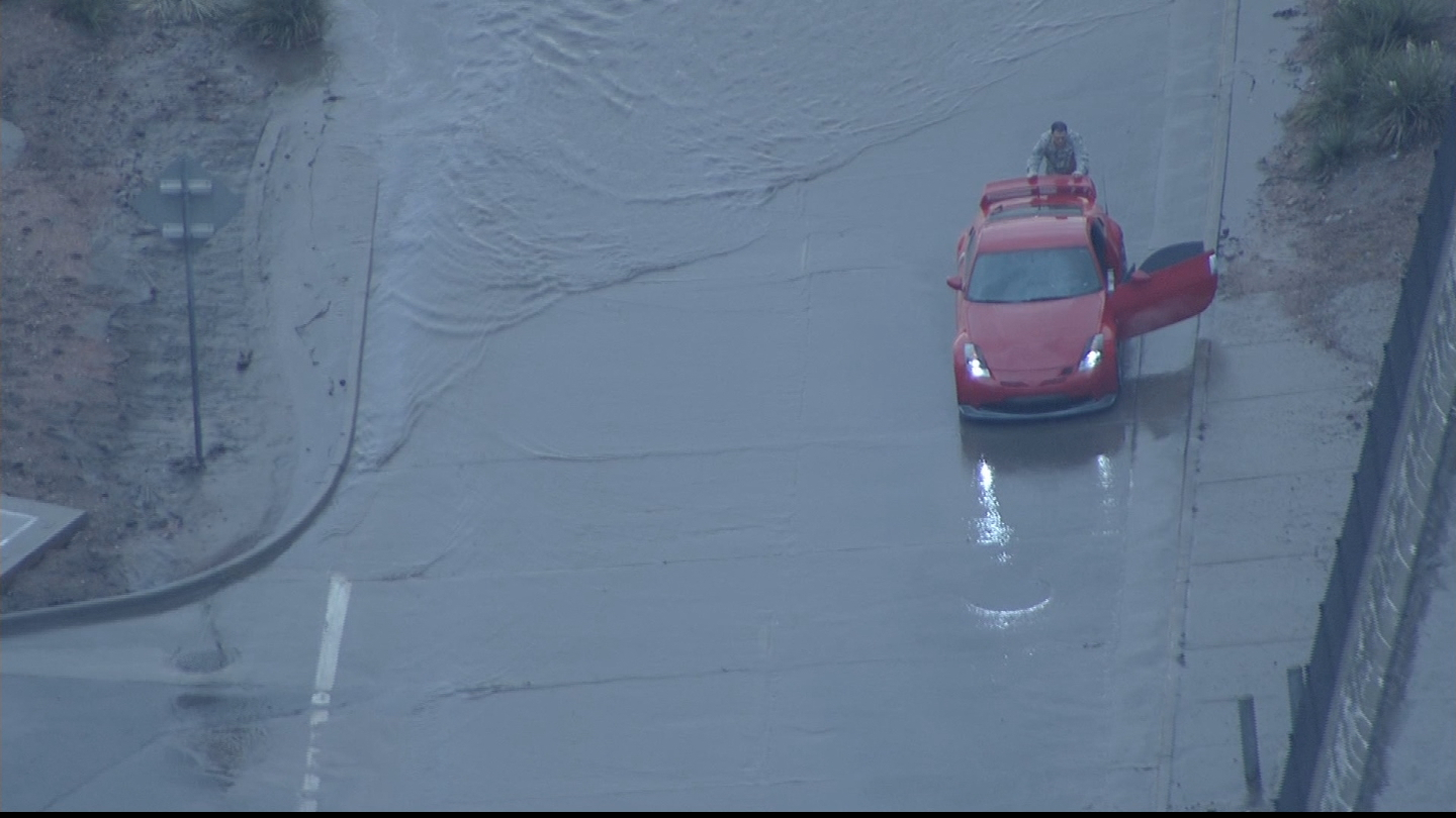 Copter4 flew over as Seth Vose pushed his car out of the water (credit: CBS)