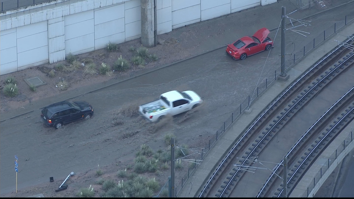 Copter4 flew over a stranded car in the flooding on the on-ramp from Broadway to I-25 (credit: CBS)
