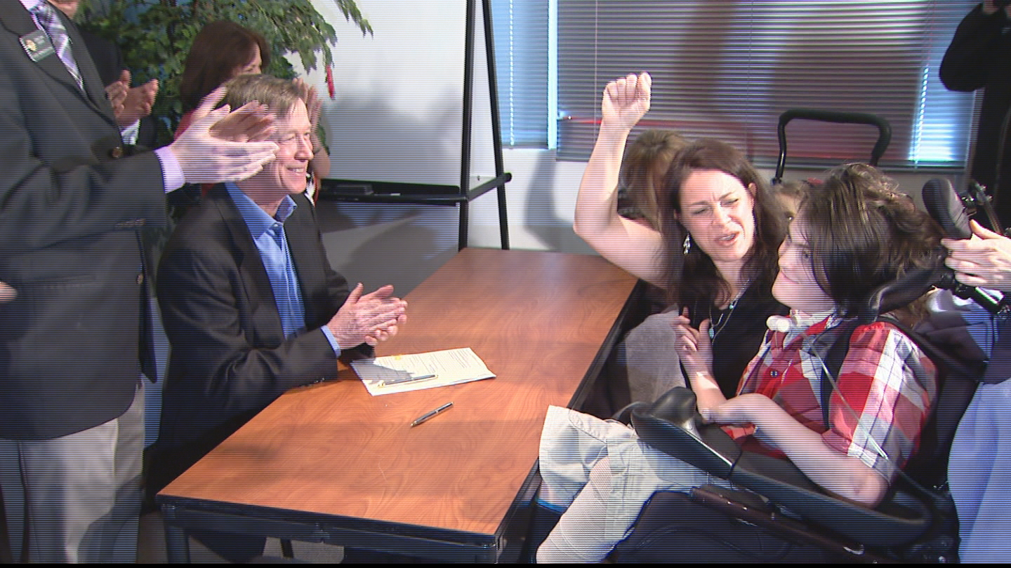 Gov. John Hickenlooper signs the medical marijuana in schools bill into law (credit: CBS)