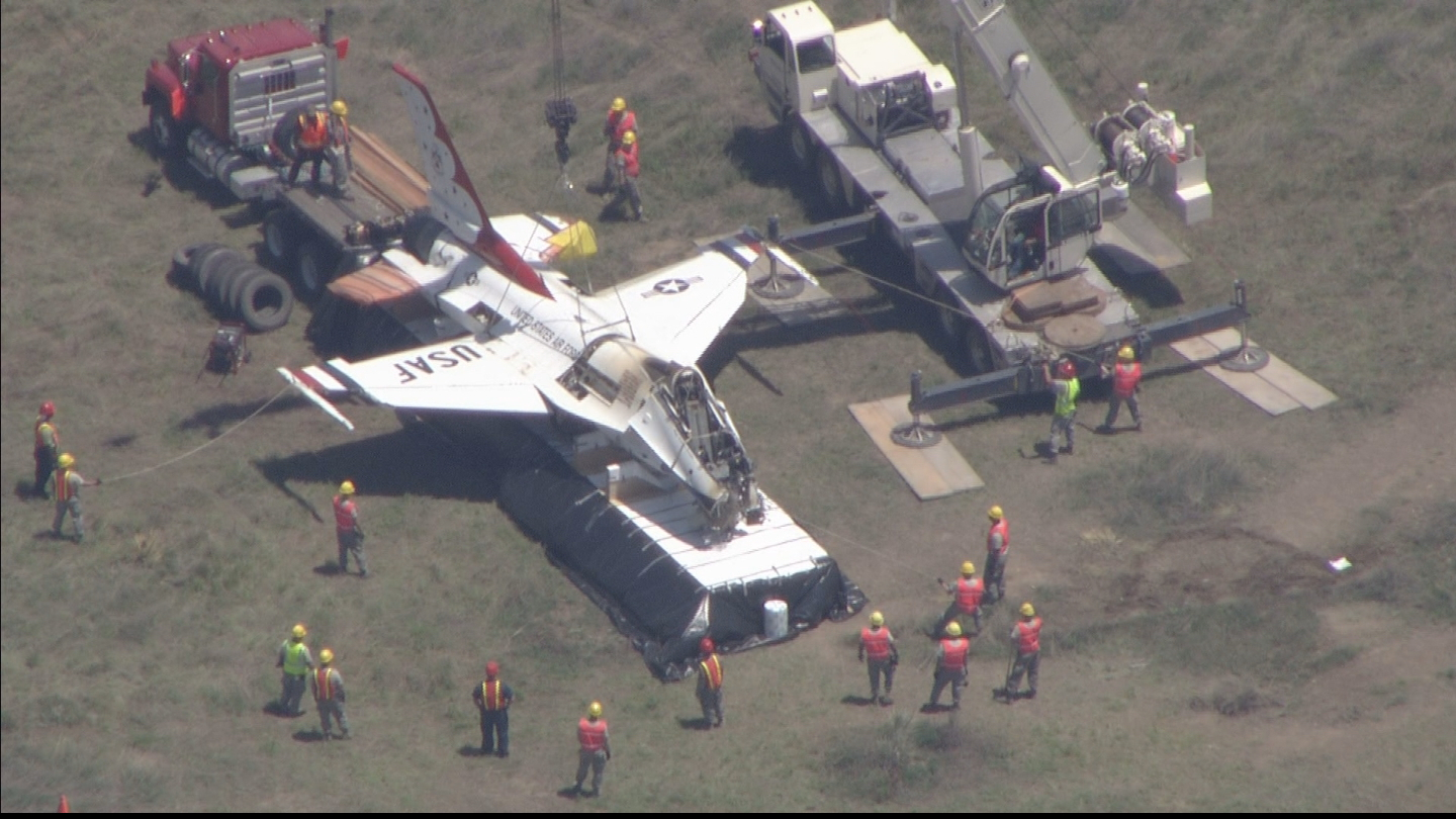 Copter4 flew over as the Thunderbird jet was placed on a semi trailer (credit: CBS)