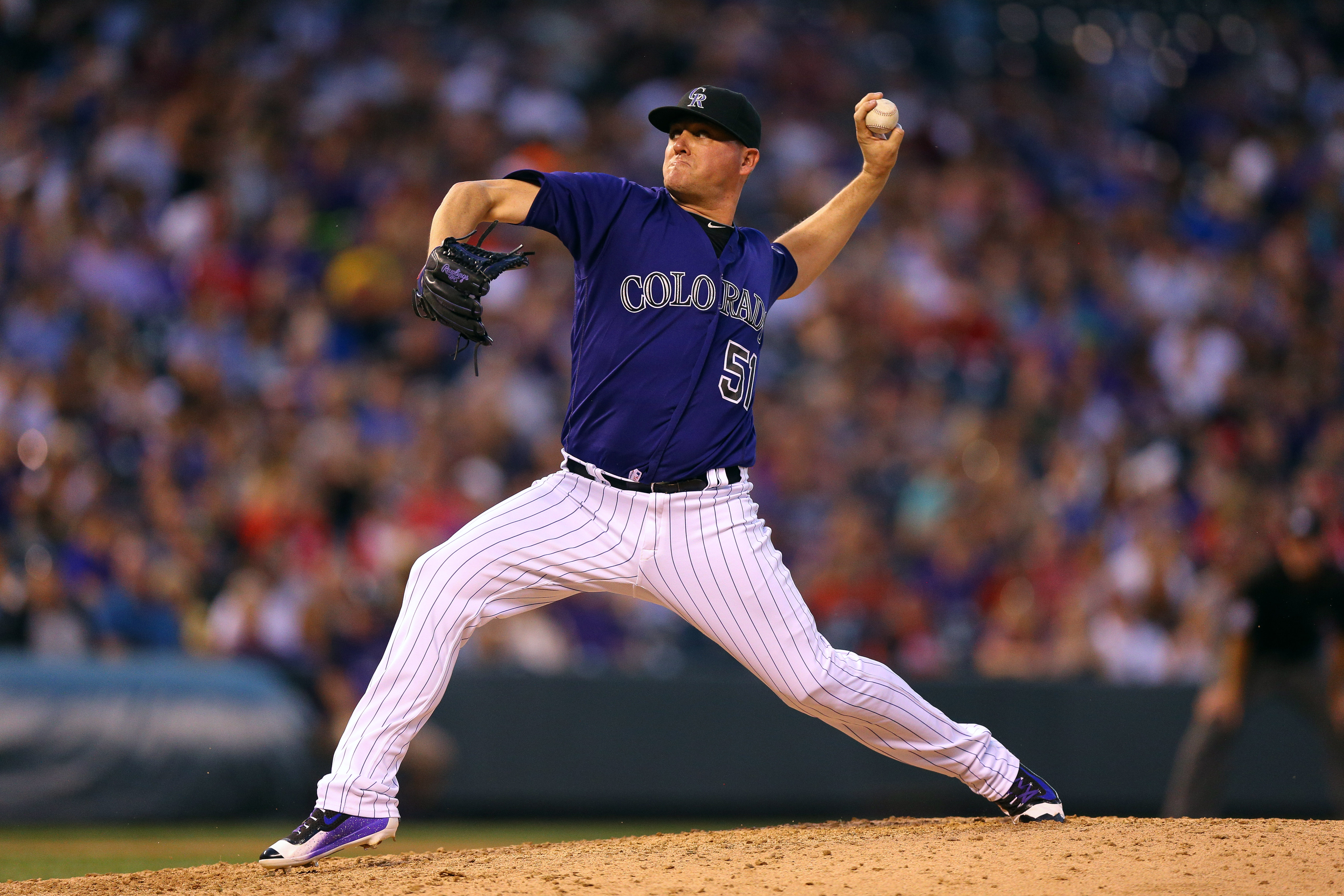 Relief pitcher Jake McGee #51 of the Colorado Rockies delivers to home plate during the seventh inning against the Philadelphia Phillies at Coors Field on July 8, 2016 in Denver, Colorado. (Photo by Justin Edmonds/Getty Images)