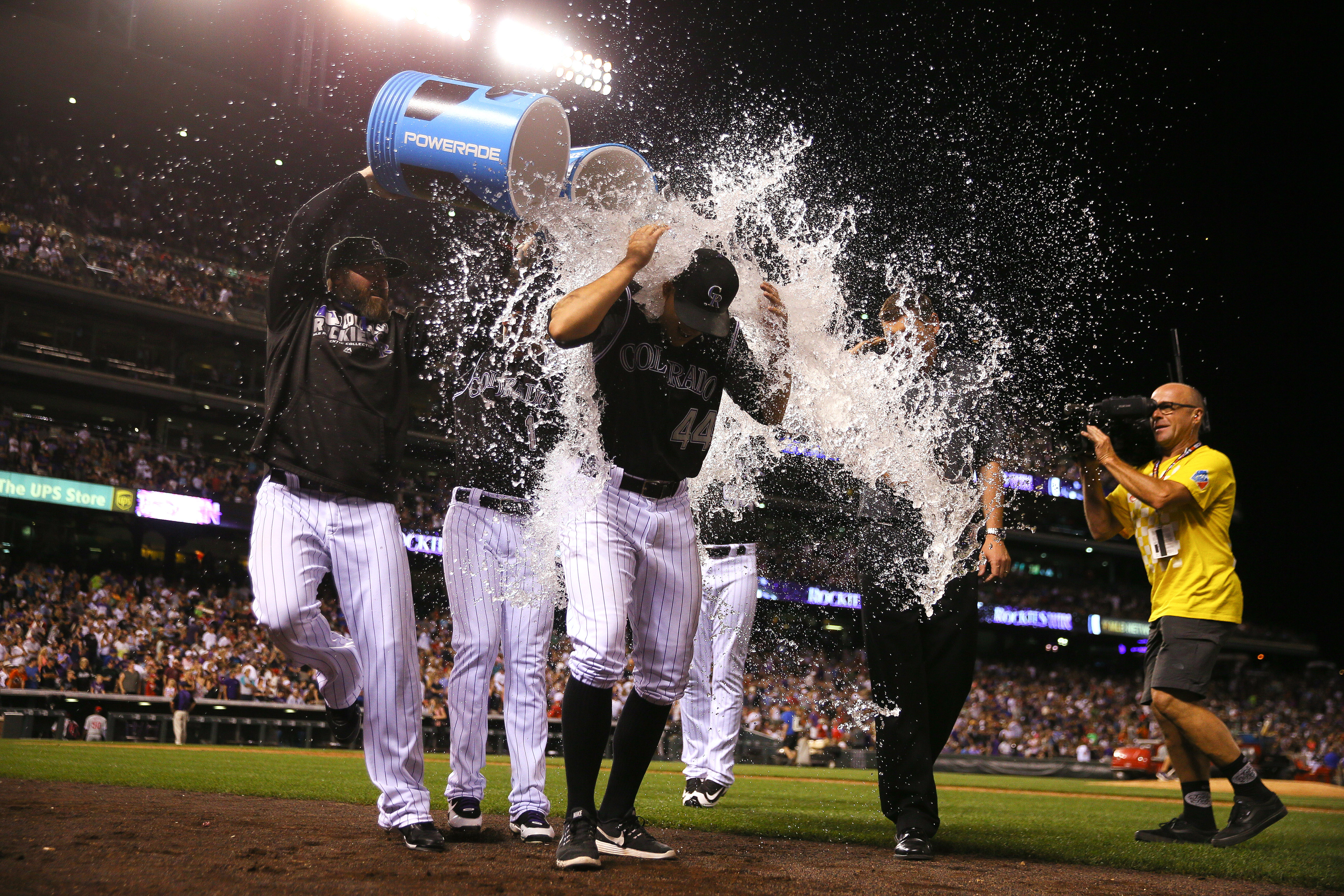 Tyler Anderson #44 of the Colorado Rockies gets a shower from teammates Jason Motte #30 and Brandon Barnes #1 after leading the team to the win against the Philadelphia Phillies at Coors Field on July 9, 2016 in Denver, Colorado. The Rockies defeated the Phillies 8-3. (Photo by Justin Edmonds/Getty Images)